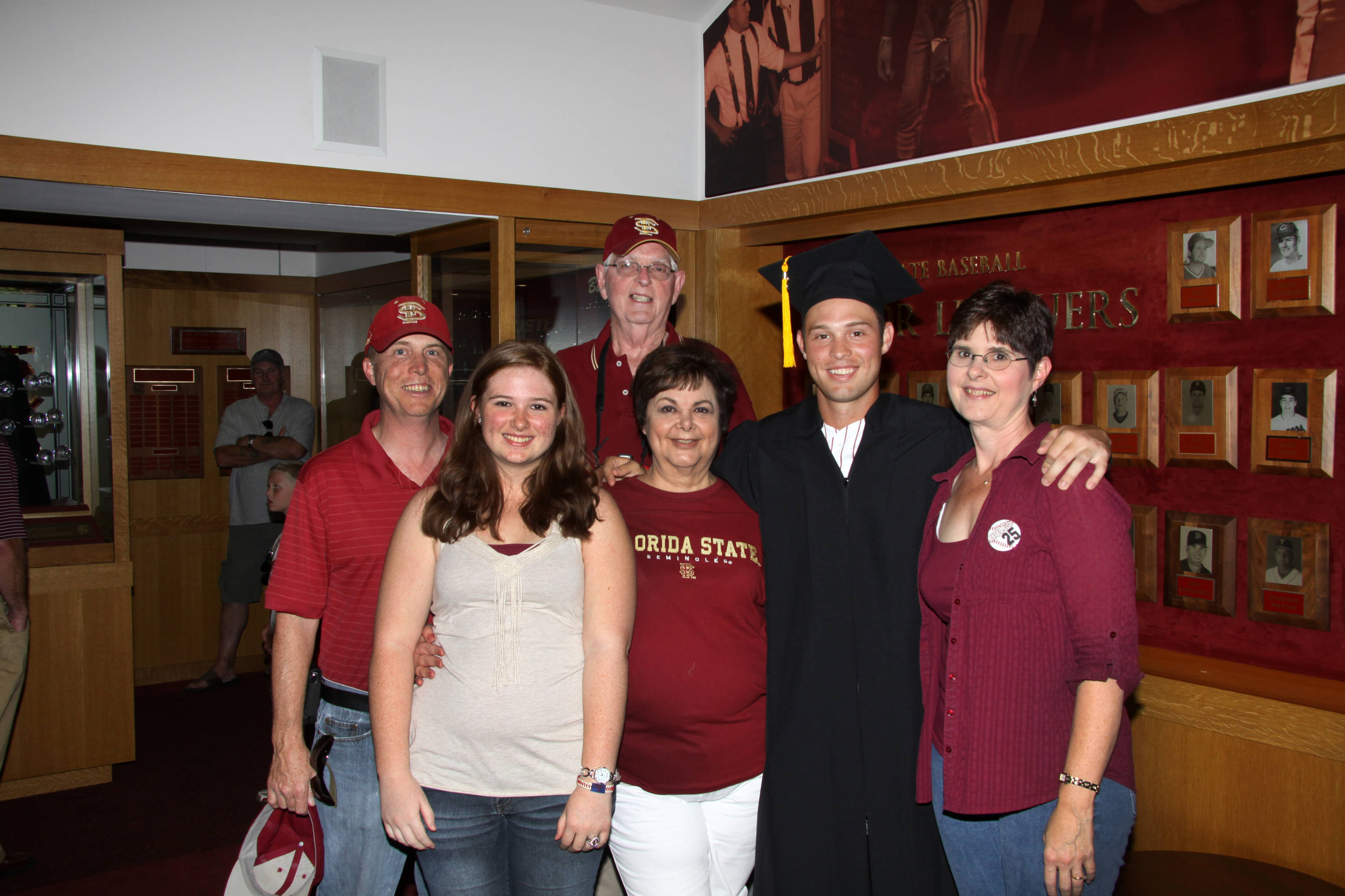 2011 Spring Graduation Ceremony held at Dick Howser Stadium to honor the graduating baseball seniors. Mike McGee (25) and family