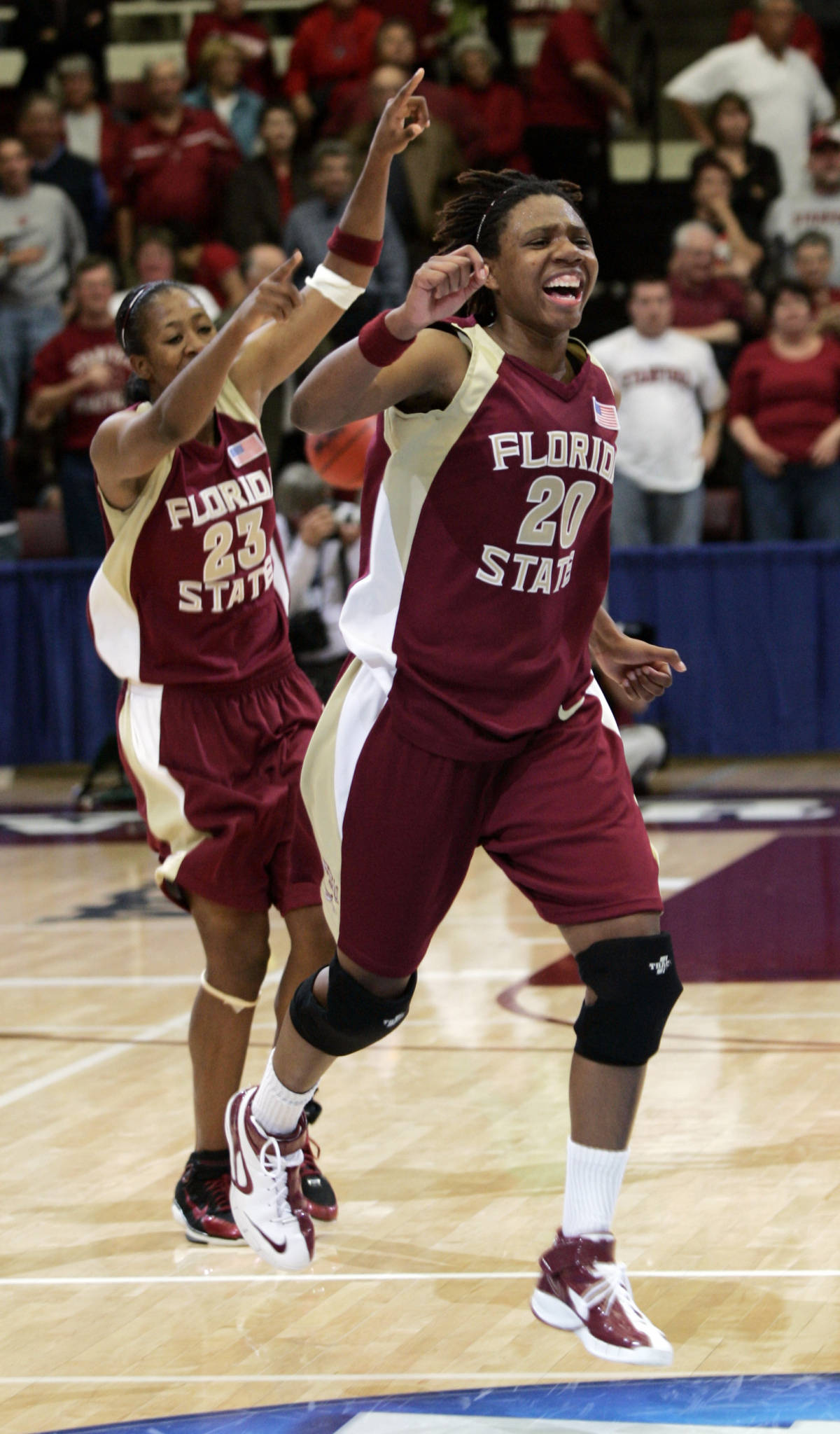Florida State guard Tanae Davis-Cain (20) and guard Alicia Gladden (23) celebrate after they upset Stanford, 68-61, in a second-round game of the NCAA women's basketball tournament in Stanford, Calif., Monday, March 19, 2007. (AP Photo/Paul Sakuma)