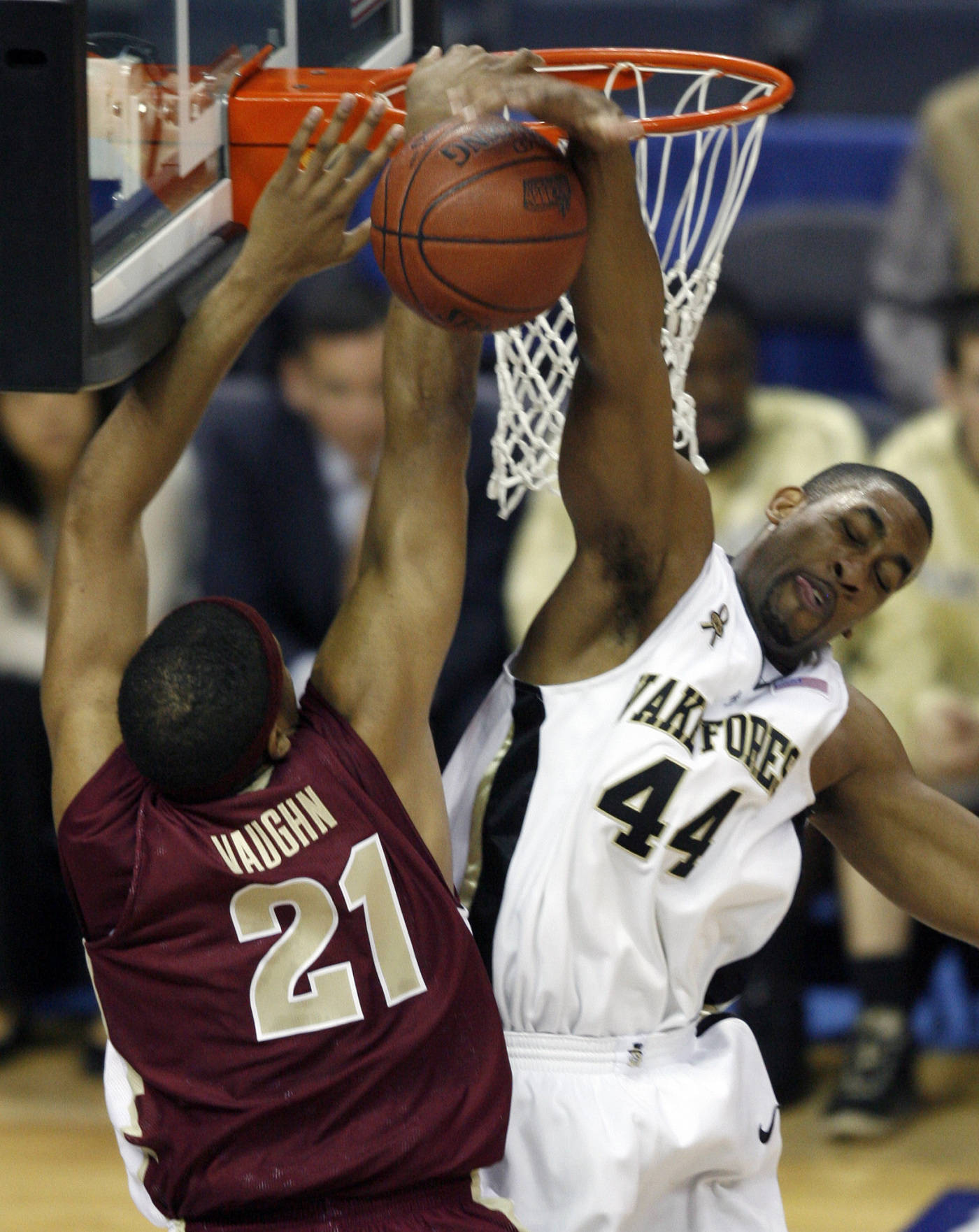 Wake Forest's David Weaver blocks a shot by Julian Vaughn during the first half. (AP Photo/Rick Havner)