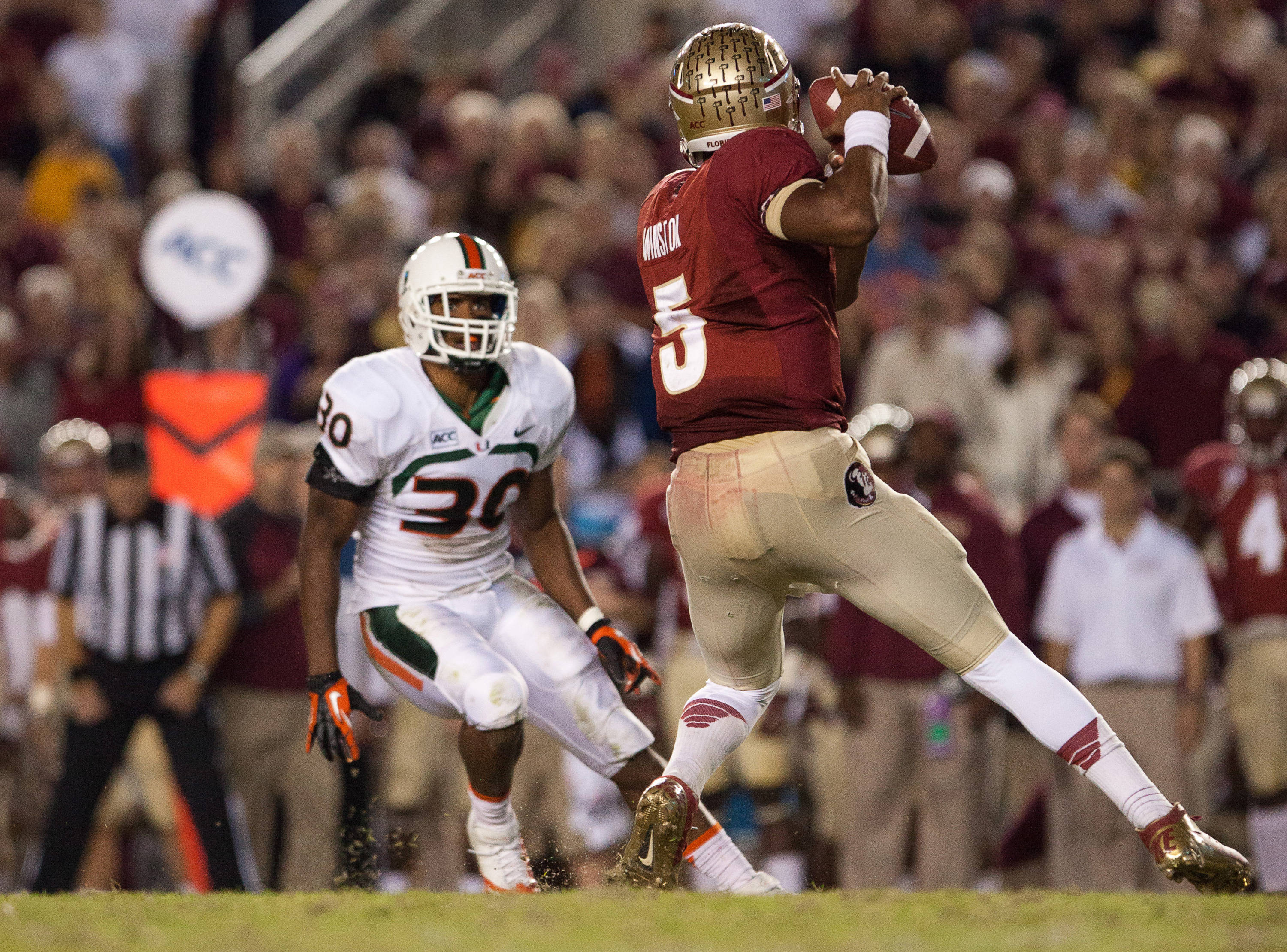Jameis Winston (5) makes a pass during FSU football's 41-14 win over Miami on Saturday, November 2, 2013 in Tallahassee, Fla. Photo by Michael Schwarz.