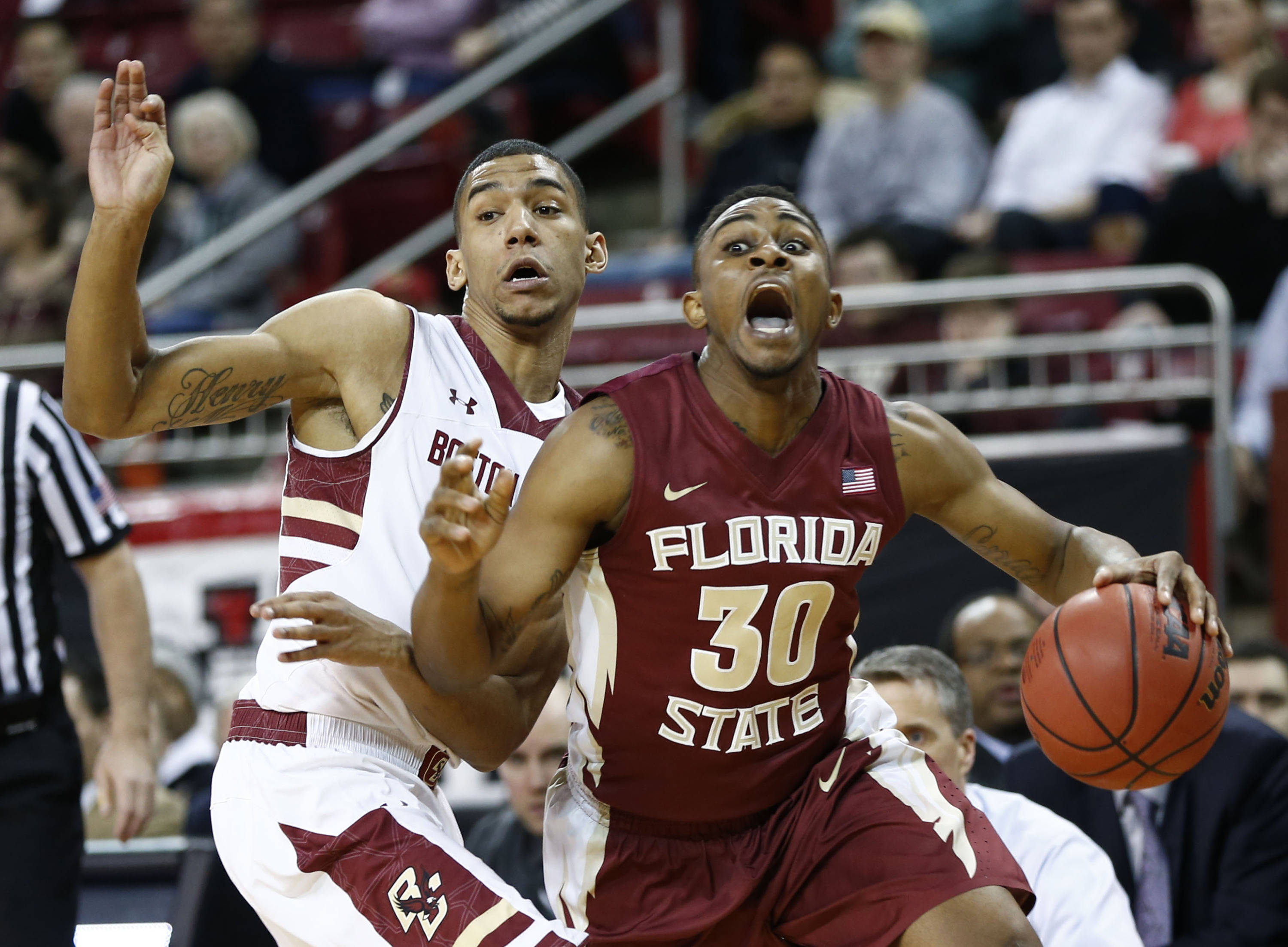 Mar 4, 2014; Chestnut Hill, MA, USA; Seminoles guard Ian Miller (30) dribbles the ball against Boston College Eagles guard Olivier Hanlan (left) during the first half. Mark L. Baer-USA TODAY Sports