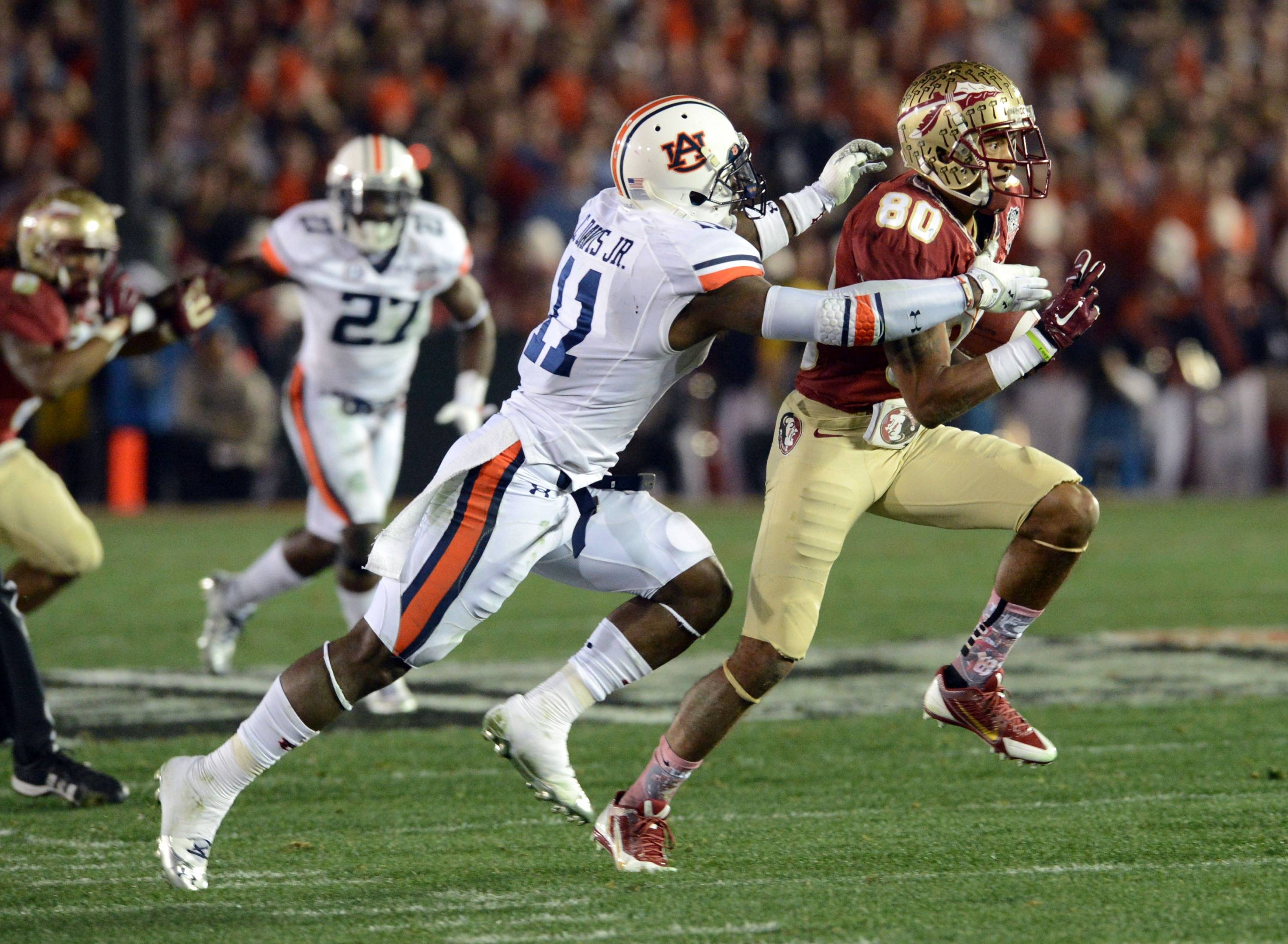 Jan 6, 2014; Pasadena, CA, USA; Florida State Seminoles wide receiver Rashad Greene (80) is tackled by Auburn Tigers cornerback Chris Davis (11) during the first half of the 2014 BCS National Championship game at the Rose Bowl.  Mandatory Credit: Jayne Kamin-Oncea-USA TODAY Sports