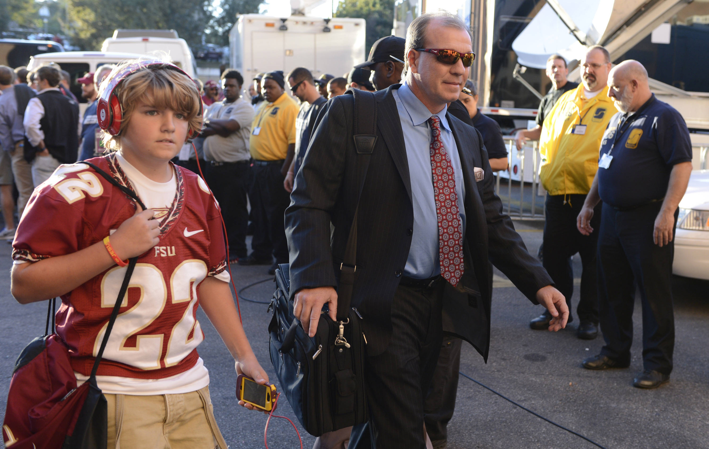 Florida State Seminoles head coach Jimbo Fisher arrives at Doak Campbell Stadium with his son Trey Fisher before the game against the Miami Hurricanes. Mandatory Credit: John David Mercer-USA TODAY Sports