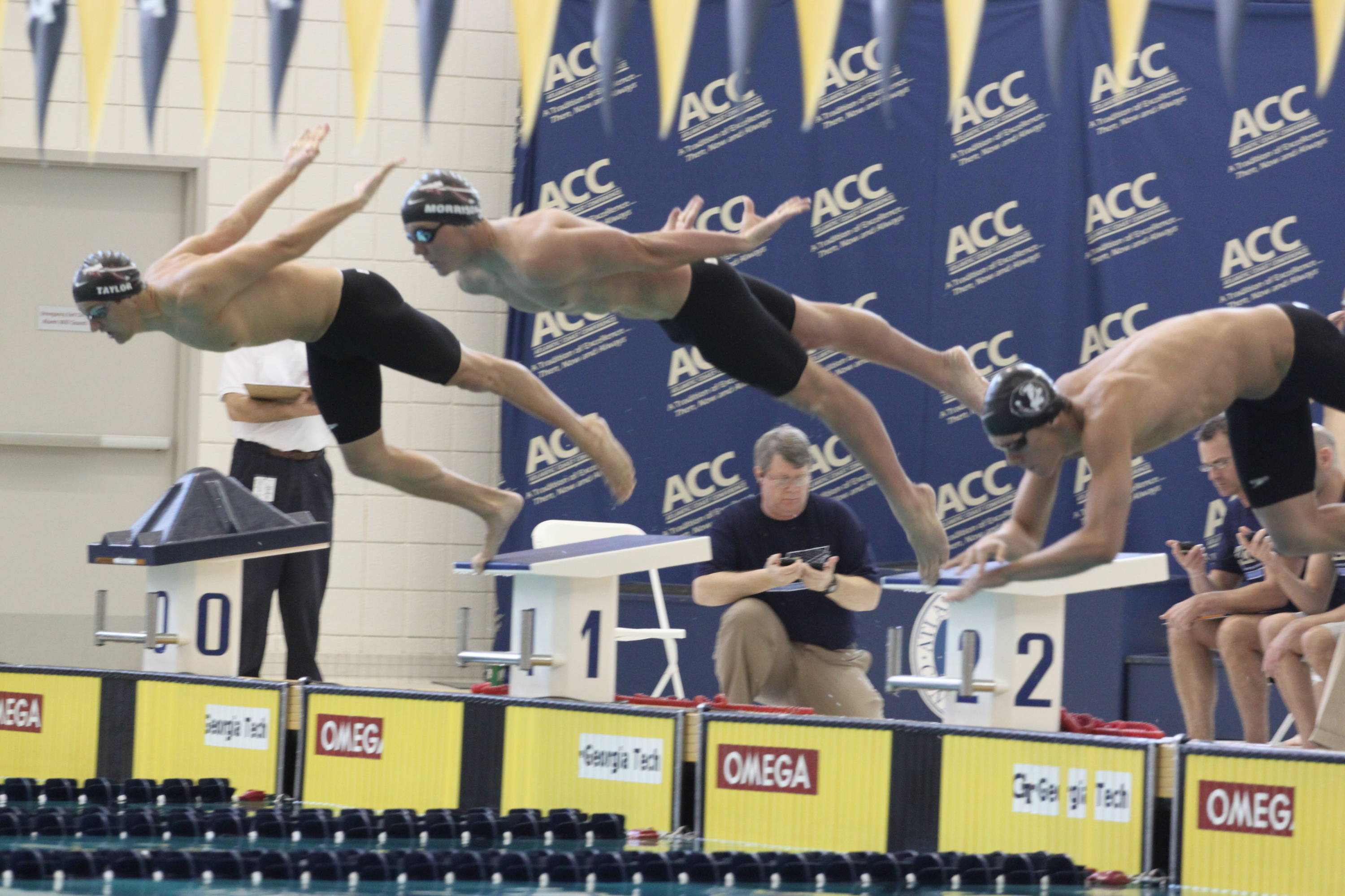 Three Seminoles dive in for the start of the 500 free