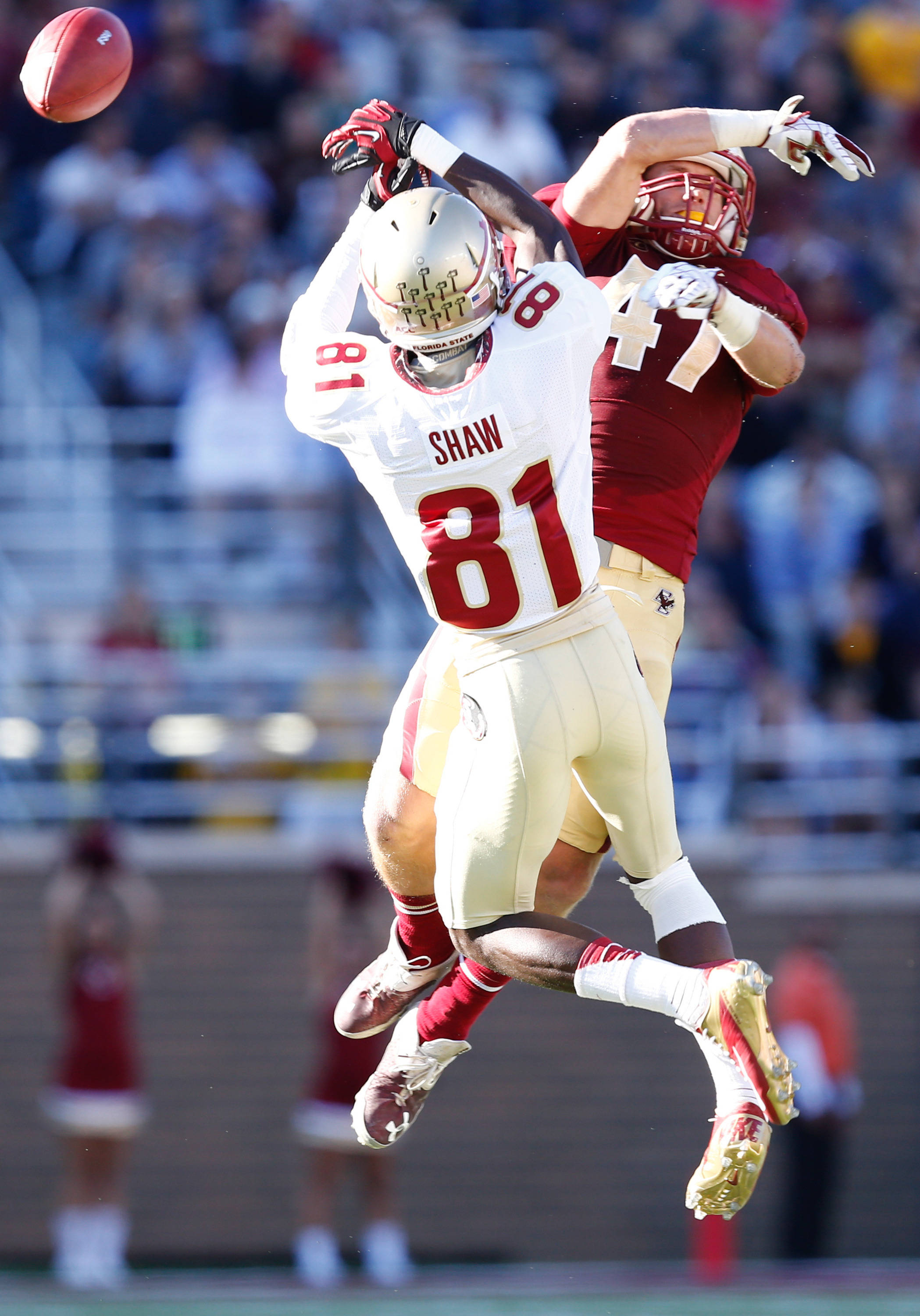 Sep 28, 2013; Boston, MA, USA; Boston College Eagles defensive back Spenser Rositano (47) knocks the ball away from Florida State Seminoles wide receiver Kenny Shaw (81) during the first half at Alumni Stadium. Mandatory Credit: Mark L. Baer-USA TODAY Sports