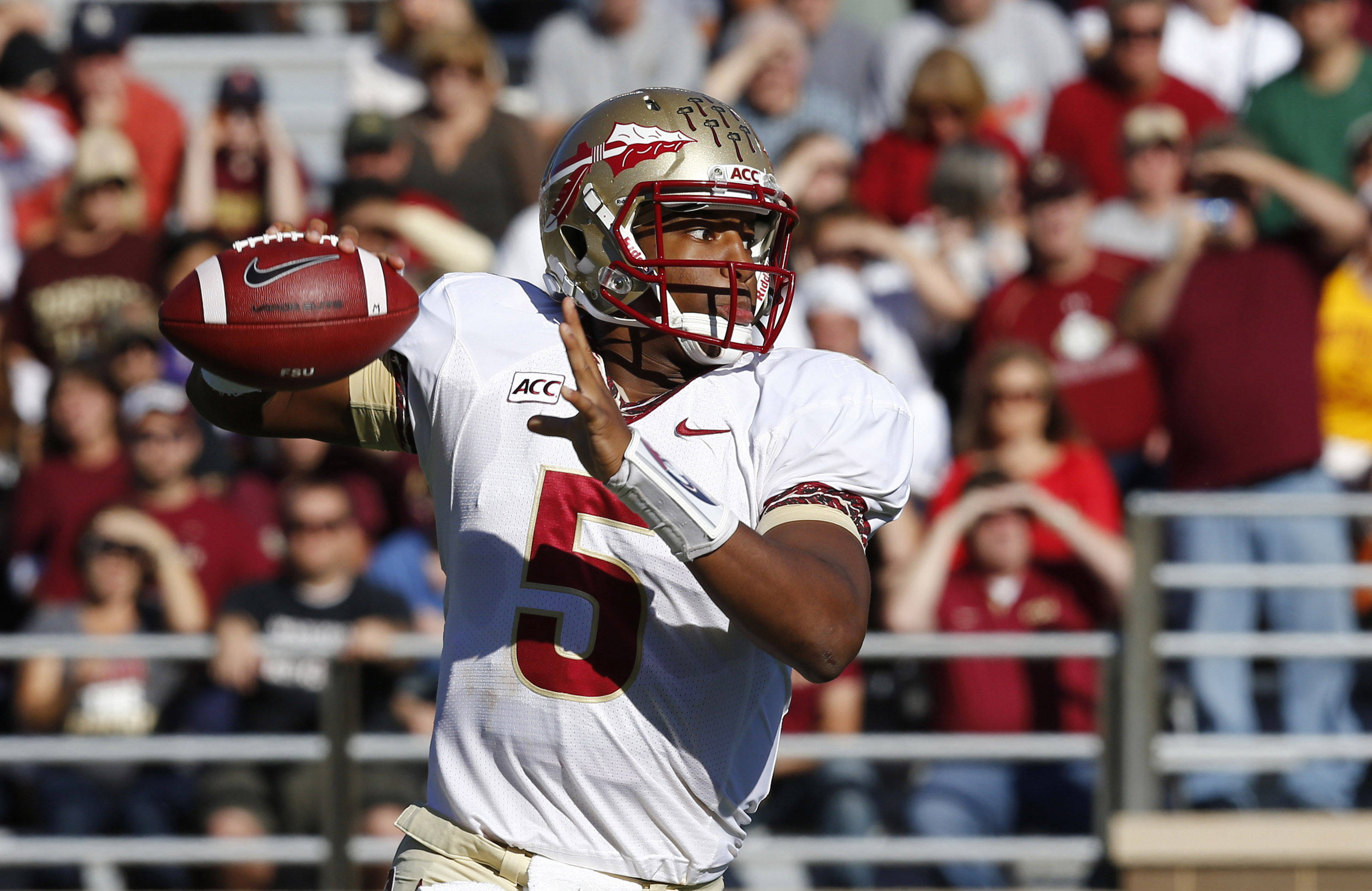 Jameis Winston (5) throws the ball. Mandatory Credit: Mark L. Baer-USA TODAY Sports