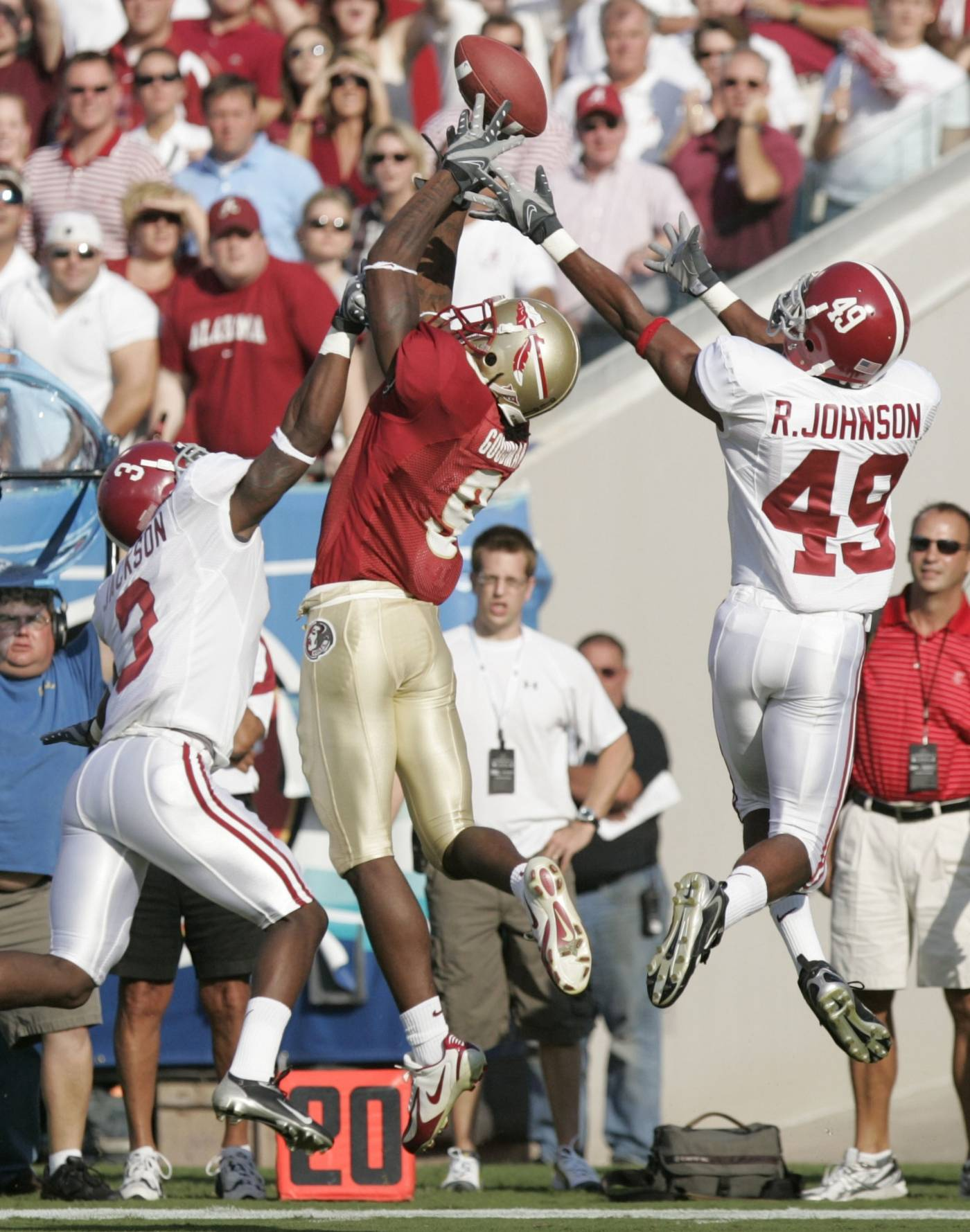 Alabama defenders Kareen Jackson, left, and Rashad Johnson, right, defend against a pass intended for Florida State receiver Richard Goodman, center, during the first quarter. The pass was incomplete. (AP Photo/Steve Cannon)