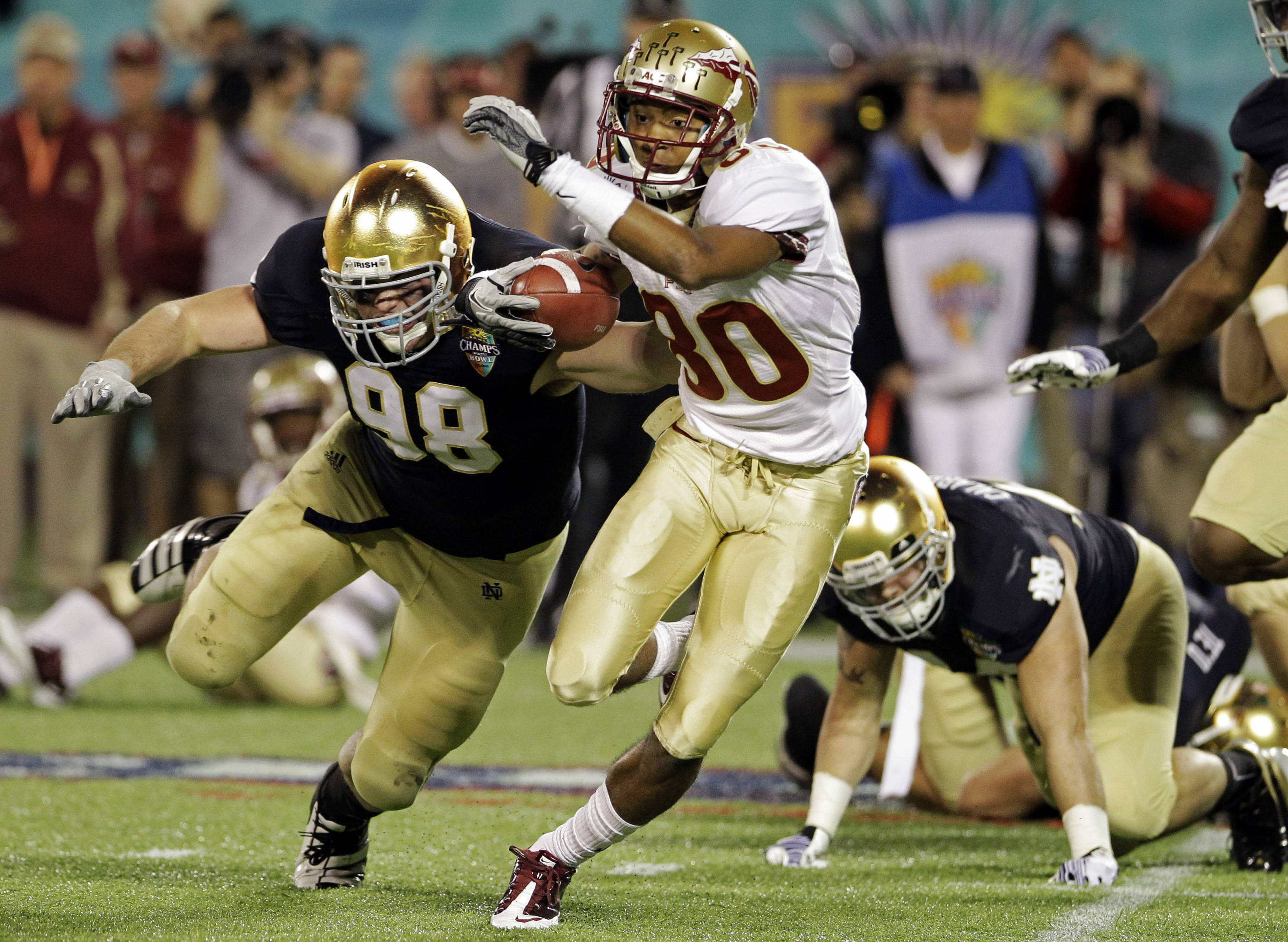 Florida State wide receiver Rashad Greene runs past Notre Dame defensive tackle Sean Cwynar after a reception in the second half. (AP Photo/John Raoux)