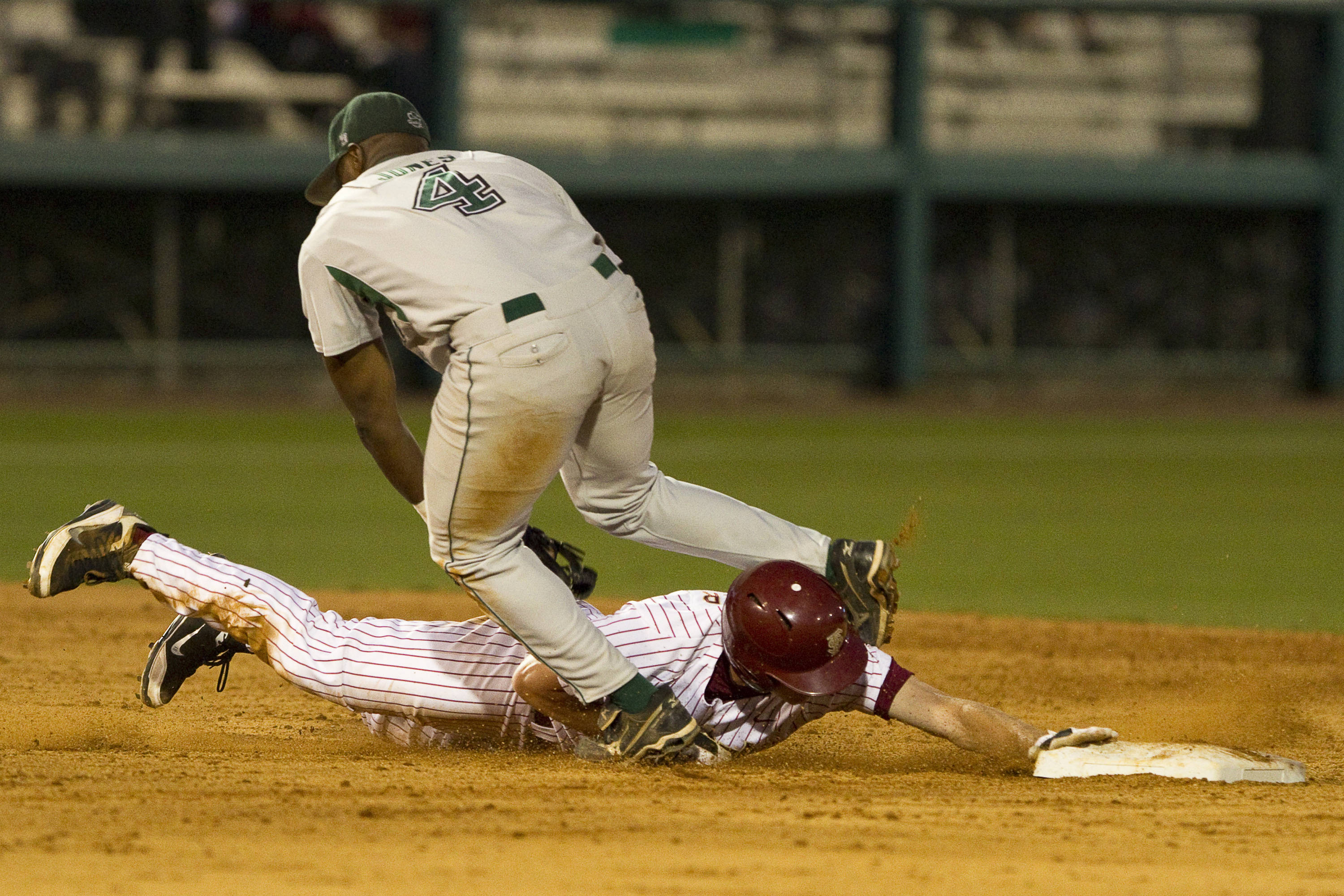 Seth Miller (18) slides under Stetson's second baseman. He was safe.