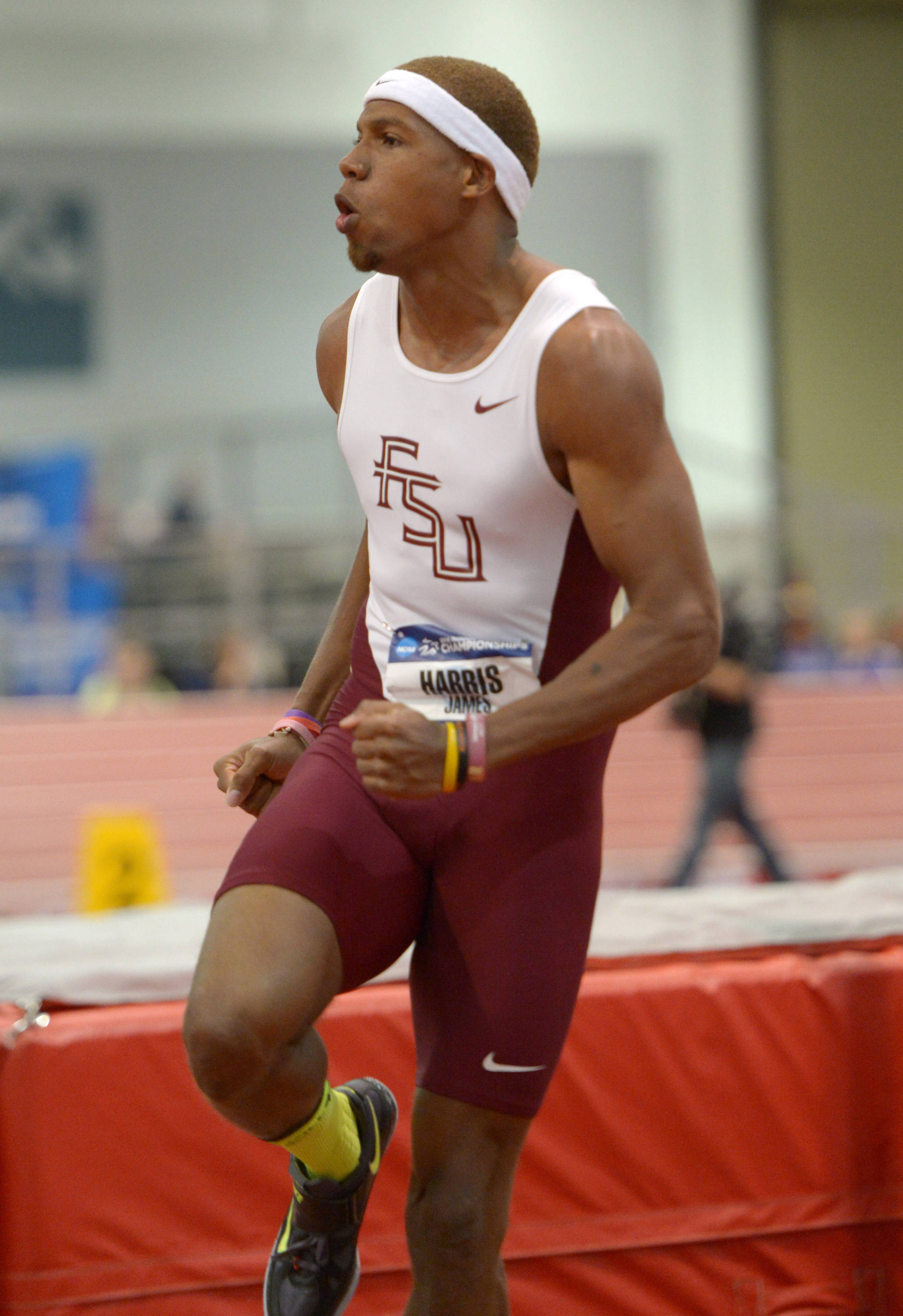Mar 14, 2014; Albuquerque, NM, USA; James Harris of Florida State celebrates after a clearance of 7-7 1/4 (2.32m) to win the high jump in the 2014 NCAA Indoor Championships at Albuquerque Convention Center. Mandatory Credit: Kirby Lee-USA TODAY Sports
