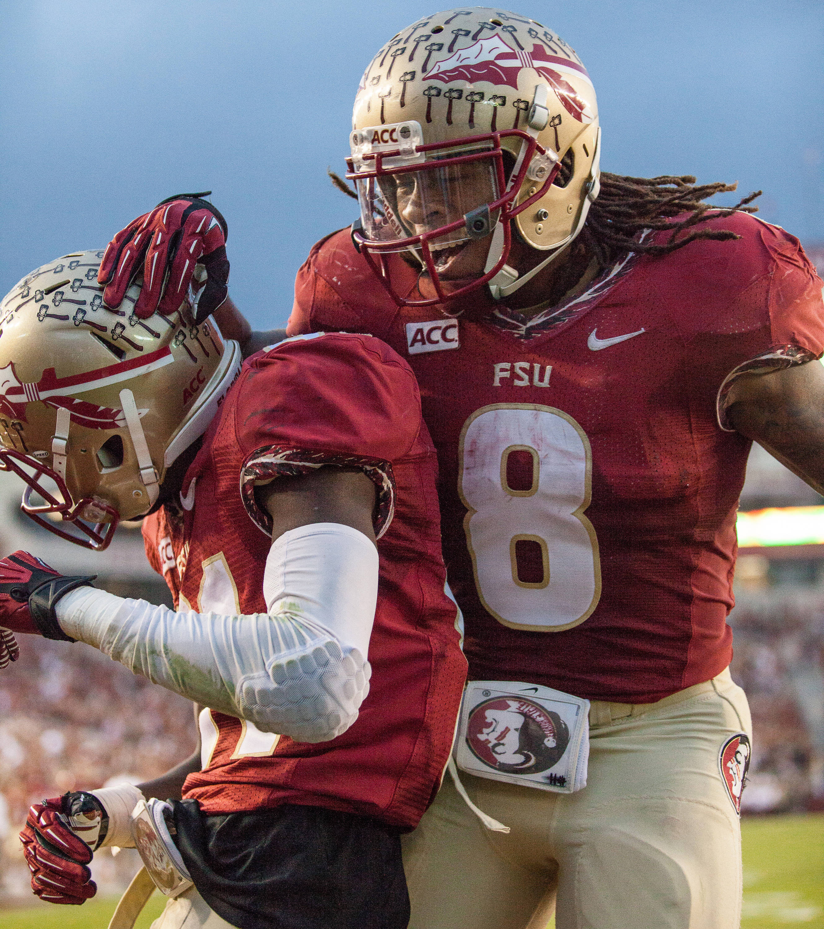 Devonta Freeman (8) and Kenny Shaw (81) celebrate after a touchdown during FSU Football's 80-14 victory over Idaho in Tallahassee, Fla on Saturday, November 23, 2013. Photos by Mike Schwarz.