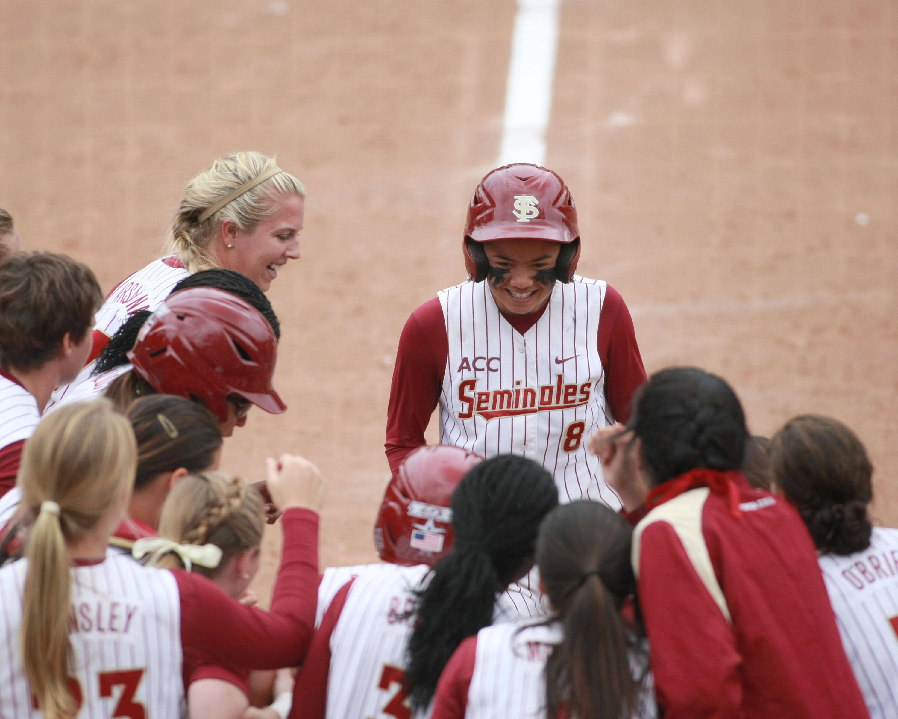 Courtney Senas is mobbed by teammates after hitting a home run in the ACC Championship game.  The Seminoles went on to win clinching a spot in the NCAA Tournament.
