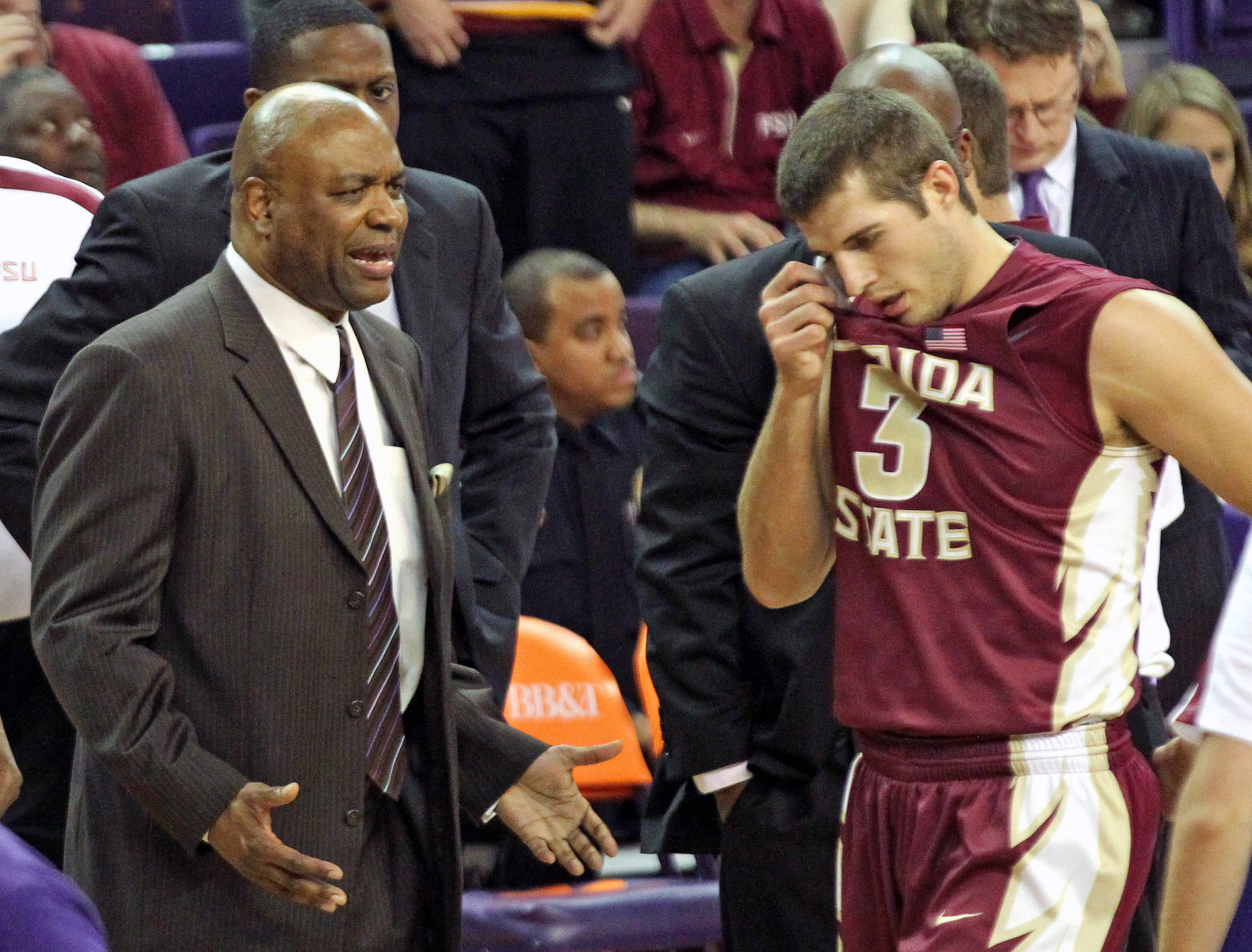 Florida State head coach Leonard Hamilton, left, talks to Luke Loucks (3) as he walks to the bench after committing a foul during the second half. (AP Photo/Anderson Independent-Mail, Mark Crammer)