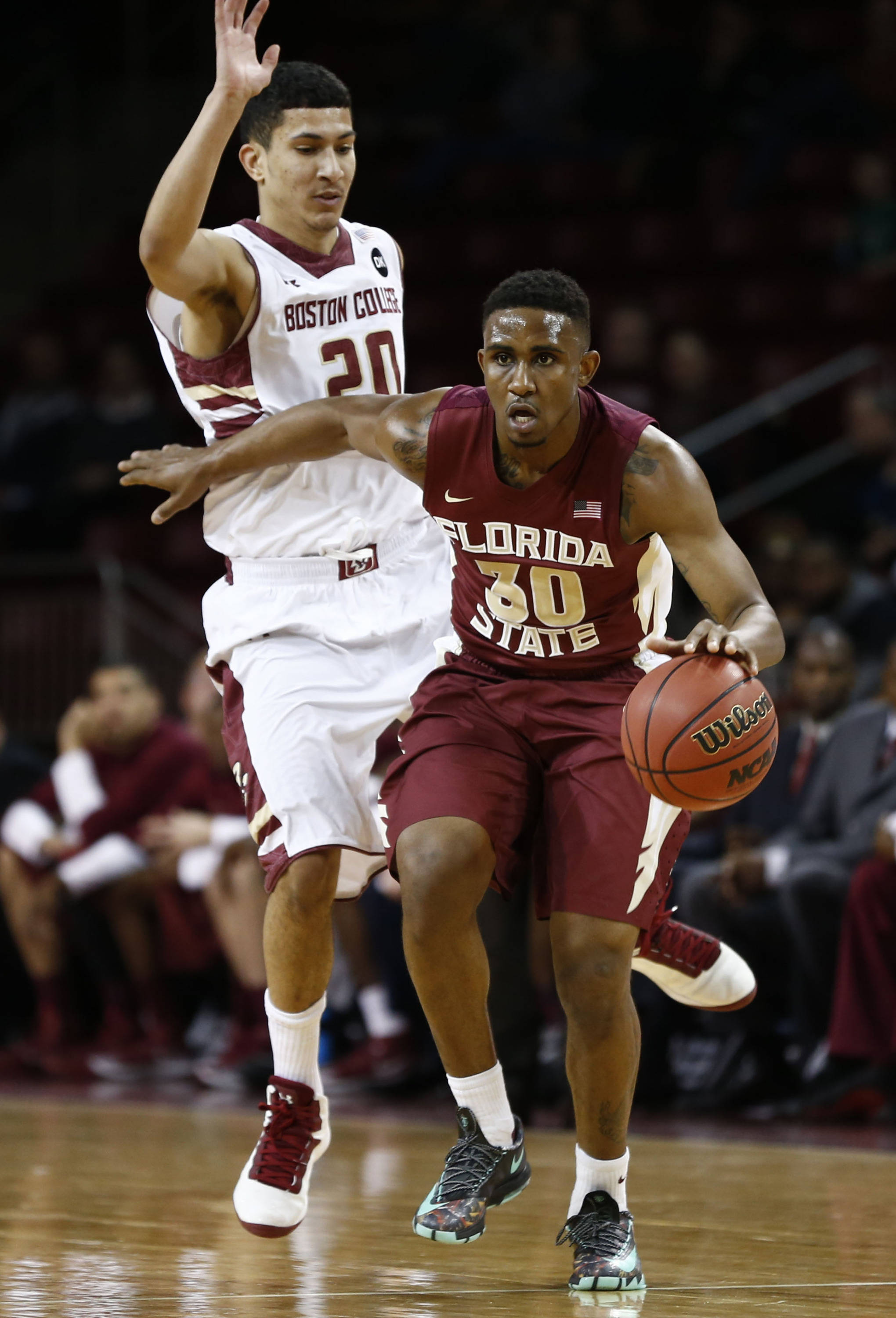 Mar 4, 2014; Chestnut Hill, MA, USA; Seminoles guard Ian Miller (30) dribbles the ball against Boston College Eagles guard Lonnie Jackson (20) during the first half. Mark L. Baer-USA TODAY Sports