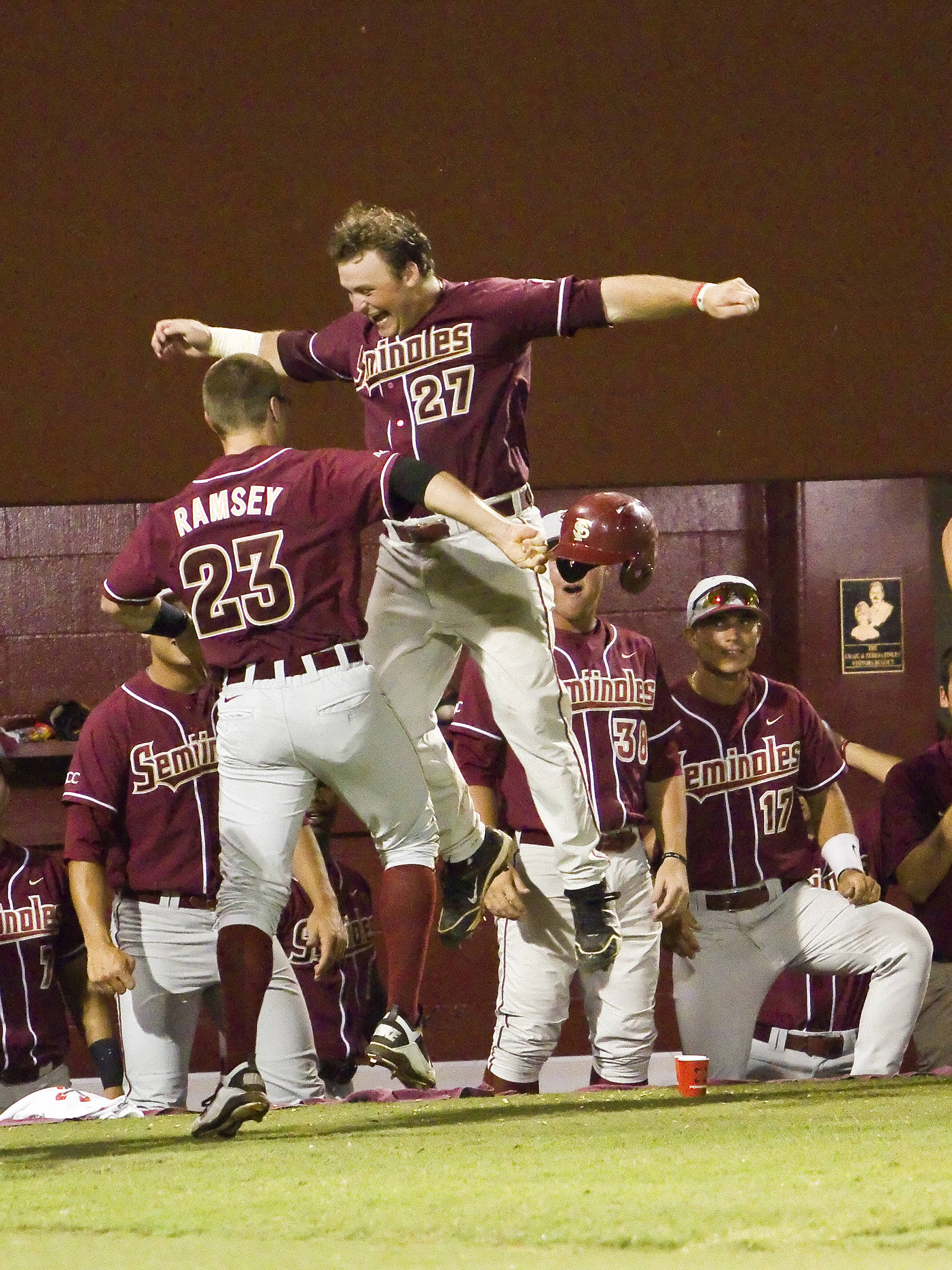 Outfielder Stuart Tapley (27) celebrating James Ramsey's (23) two run single in the 6th inning