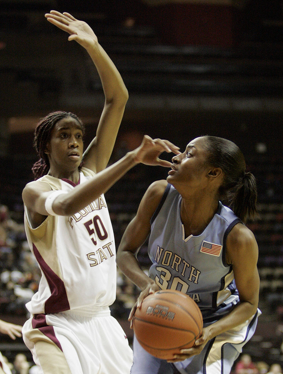 North Carolina's Latoya Pringle (30) tries to get around the defense of Florida State's Jacinta Monroe (50) in a college basketball game on Monday, Feb. 12, 2007 in Tallahassee, Fla. (AP Photo/Steve Cannon)