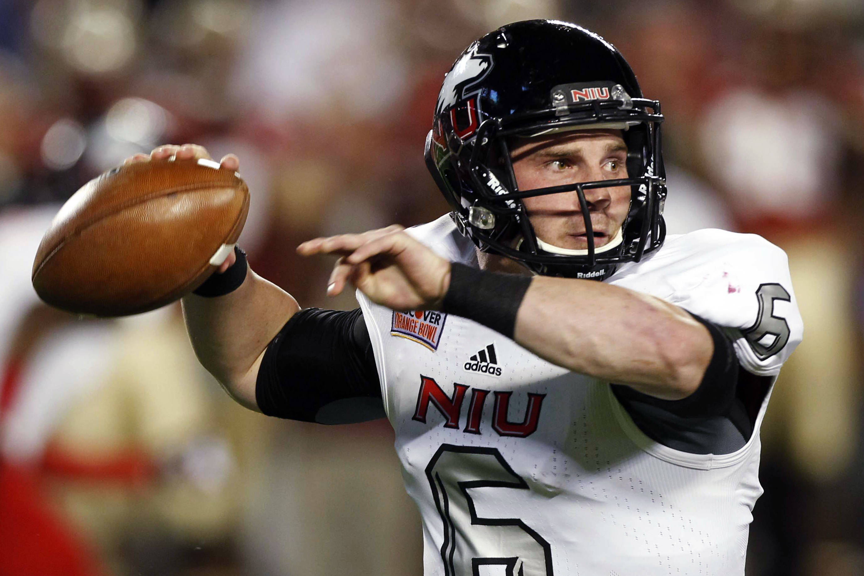 Northern Illinois quarterback Jordan Lynch (6) looks to pass during the first half of the Orange Bowl NCAA college football game against Florida State, Tuesday, Jan. 1, 2013, in Miami. (AP Photo/Alan Diaz)