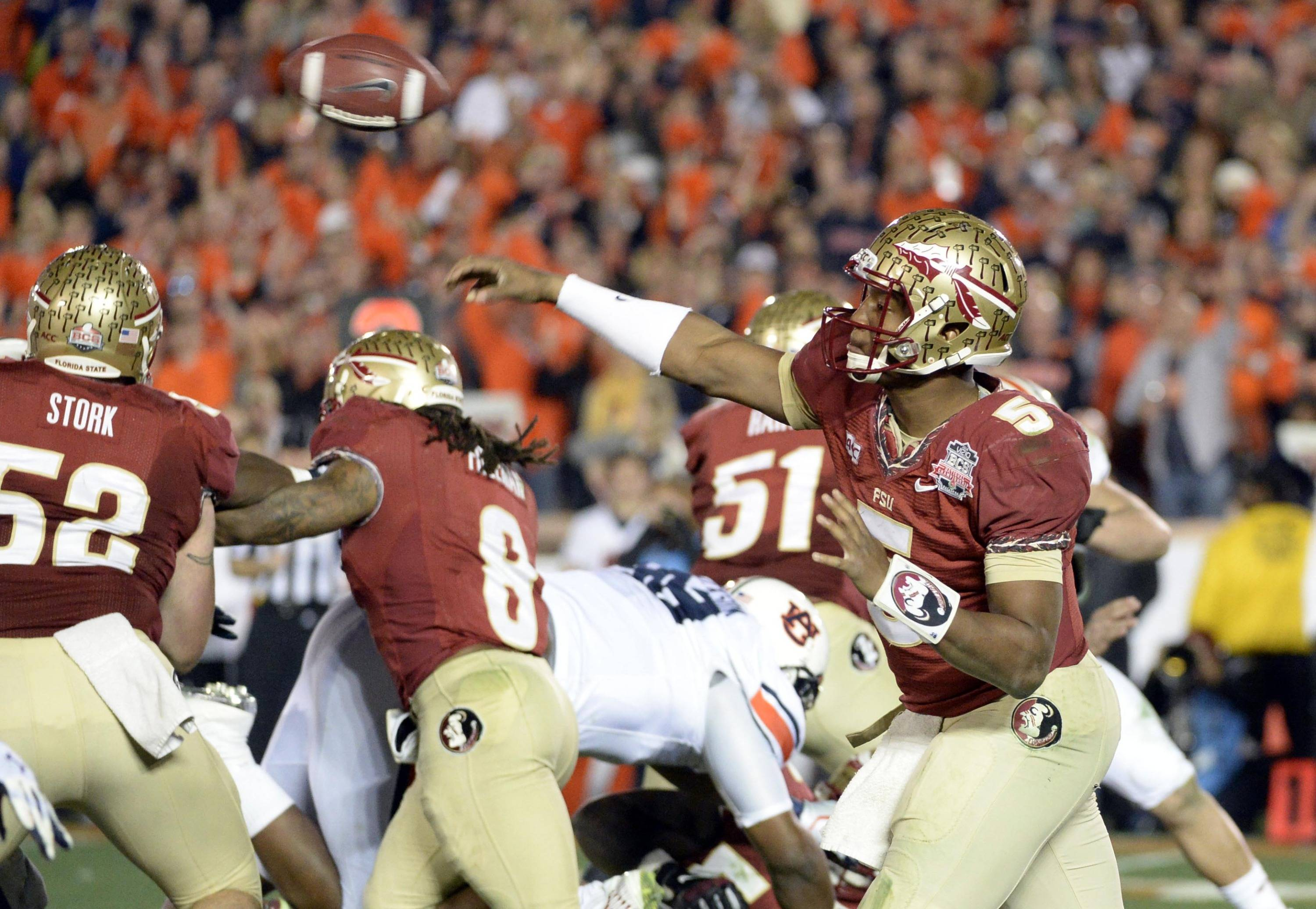 Jan 6, 2014; Pasadena, CA, USA; Florida State Seminoles quarterback Jameis Winston (5) throws against the Auburn Tigers during the second half of the 2014 BCS National Championship game at the Rose Bowl.  Mandatory Credit: Richard Mackson-USA TODAY Sports
