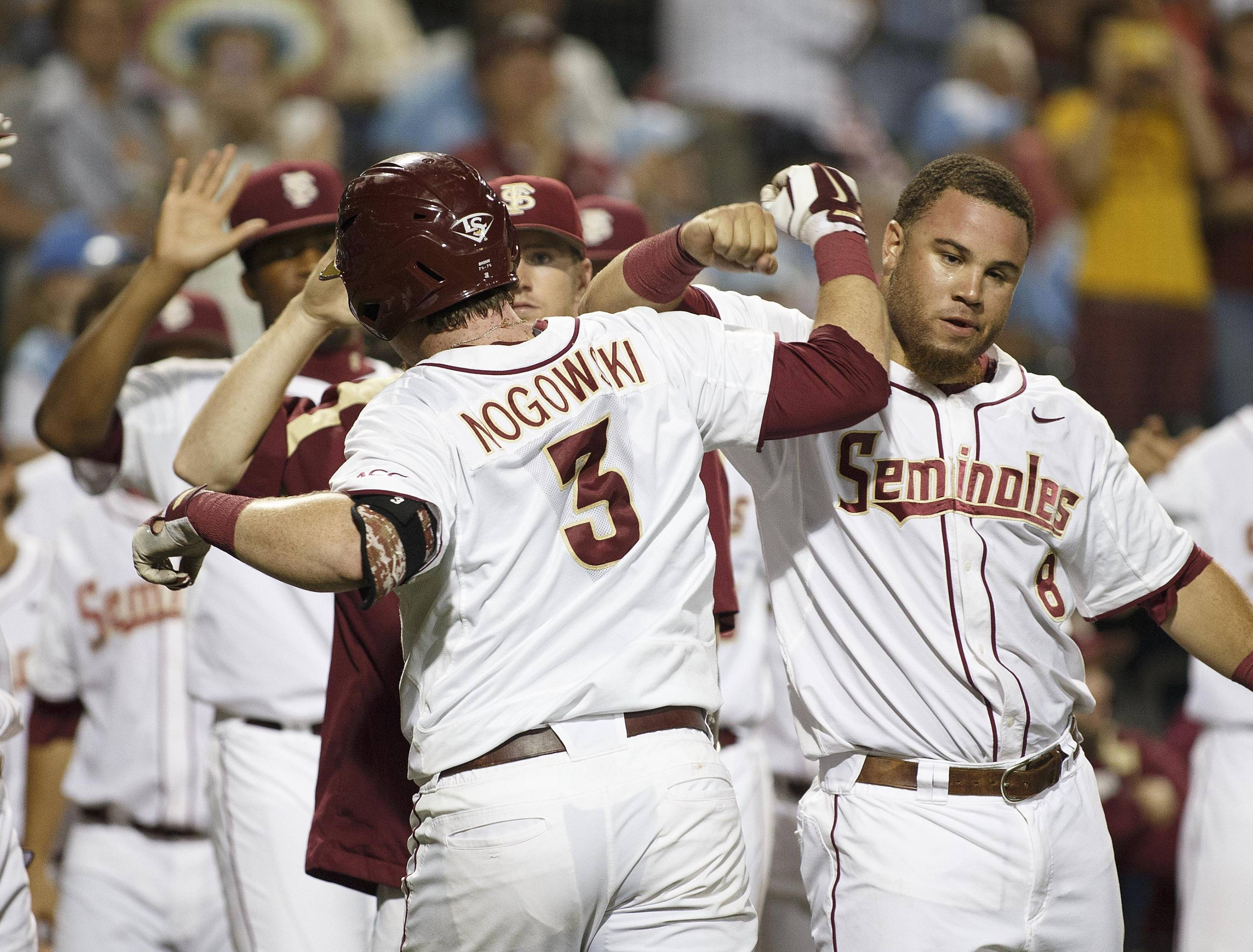 Florida State first baseman John Nogowski leads off the 7th inning with a home run and is greeted by Florida State outfielder DJ Stewart.
