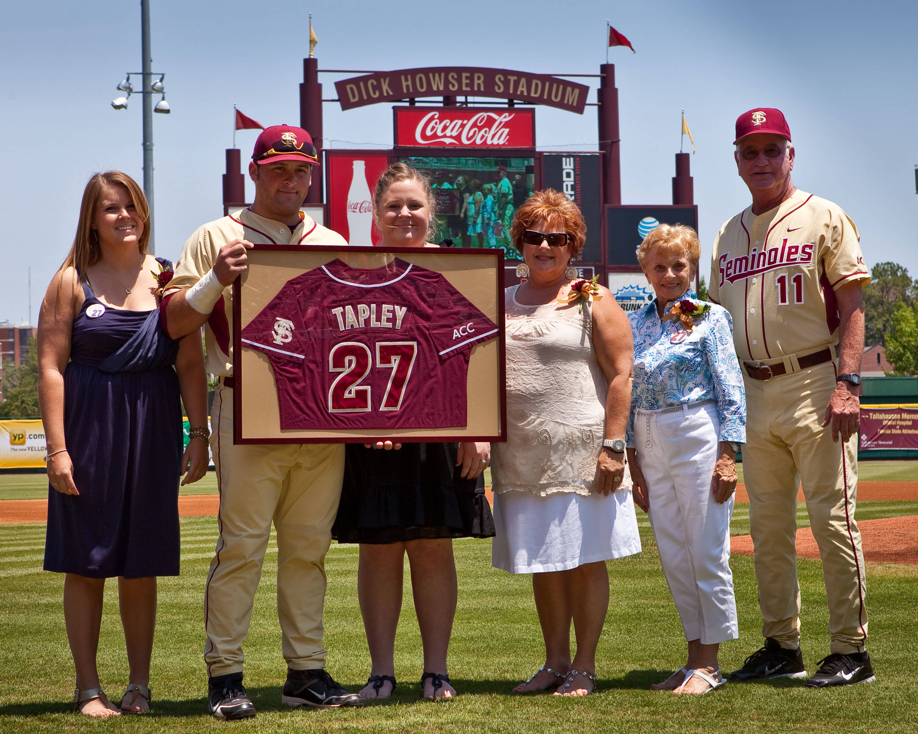 Senior Stuart Tapley and his family with Mike Martin.