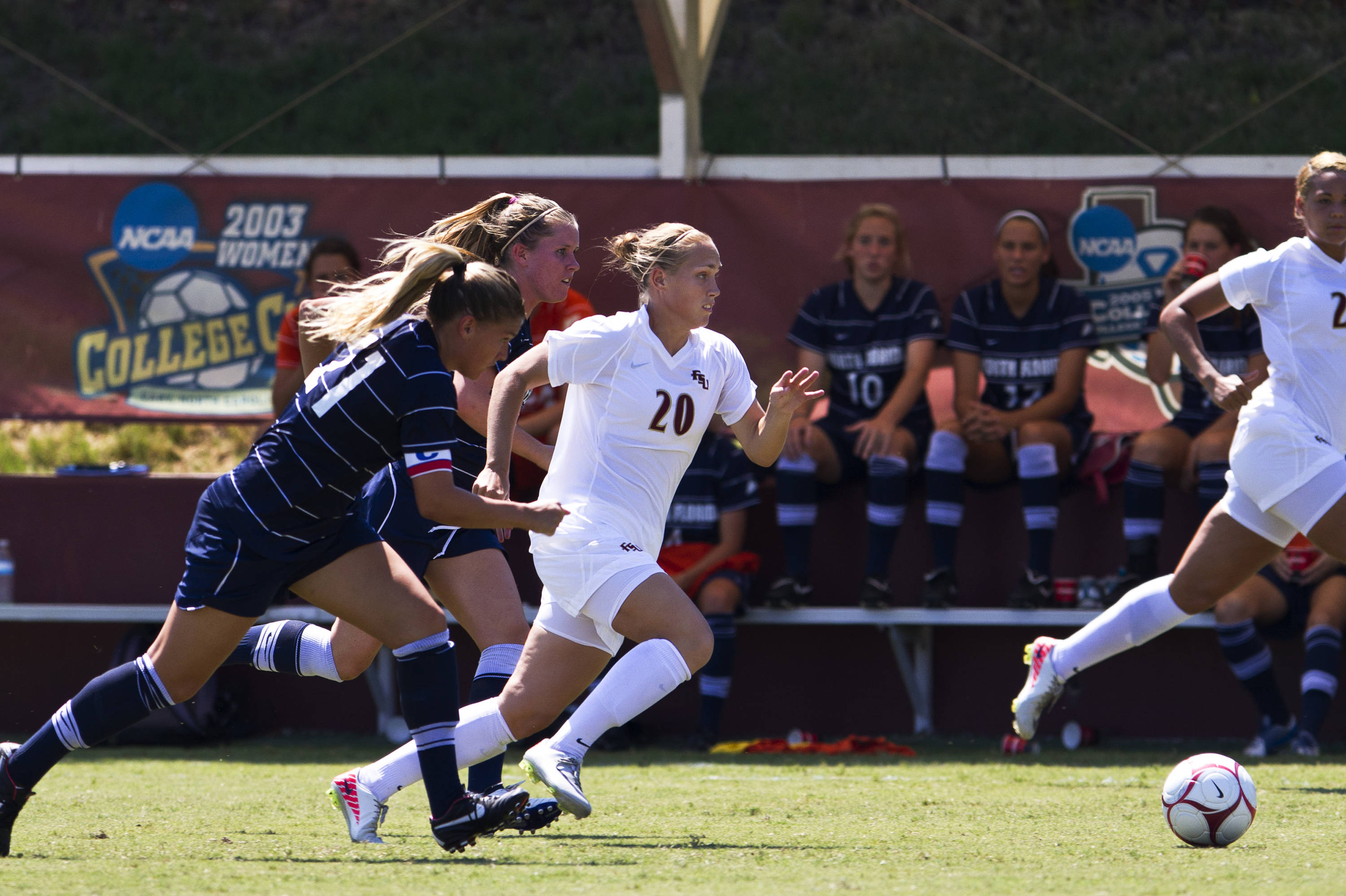 Janice Cayman (20) is pursued by two North Florida defenders as she carries the ball down the line in Sunday's game.