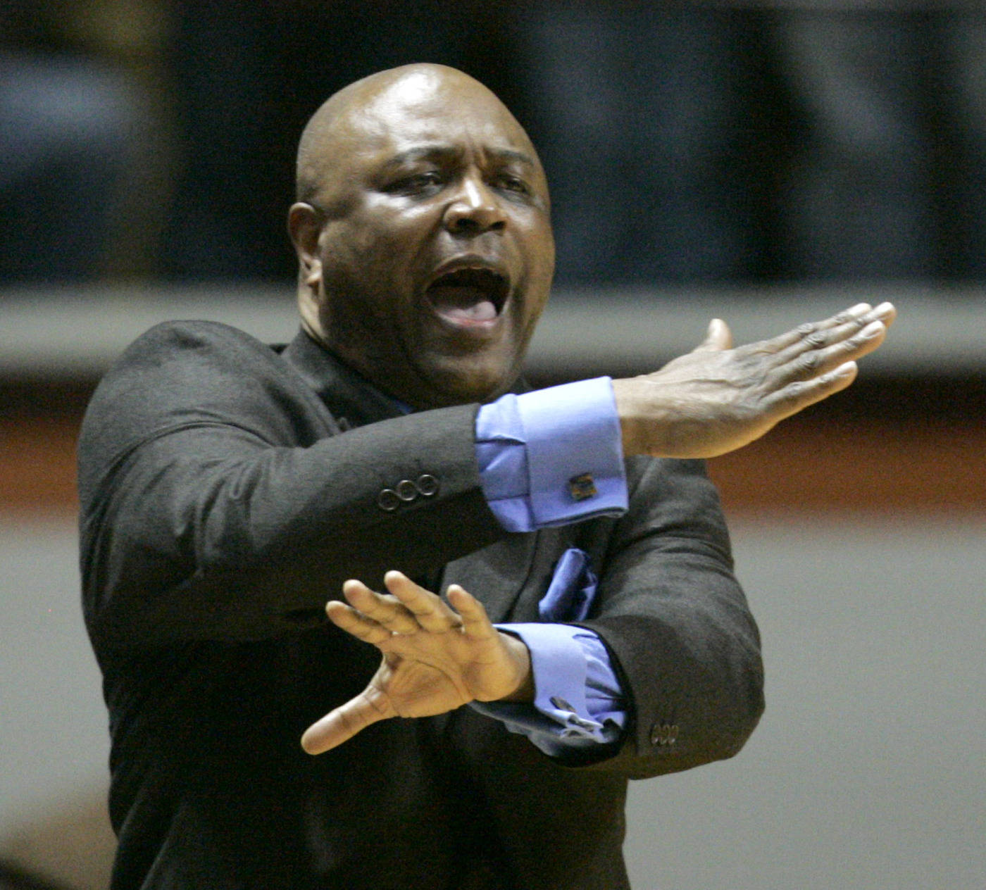 Florida State's head coach Leonard Hamilton signals his team during the first half of a college basketball game against Virginia Tech in Blacksburg, Va., Tuesday, Jan. 29, 2008.