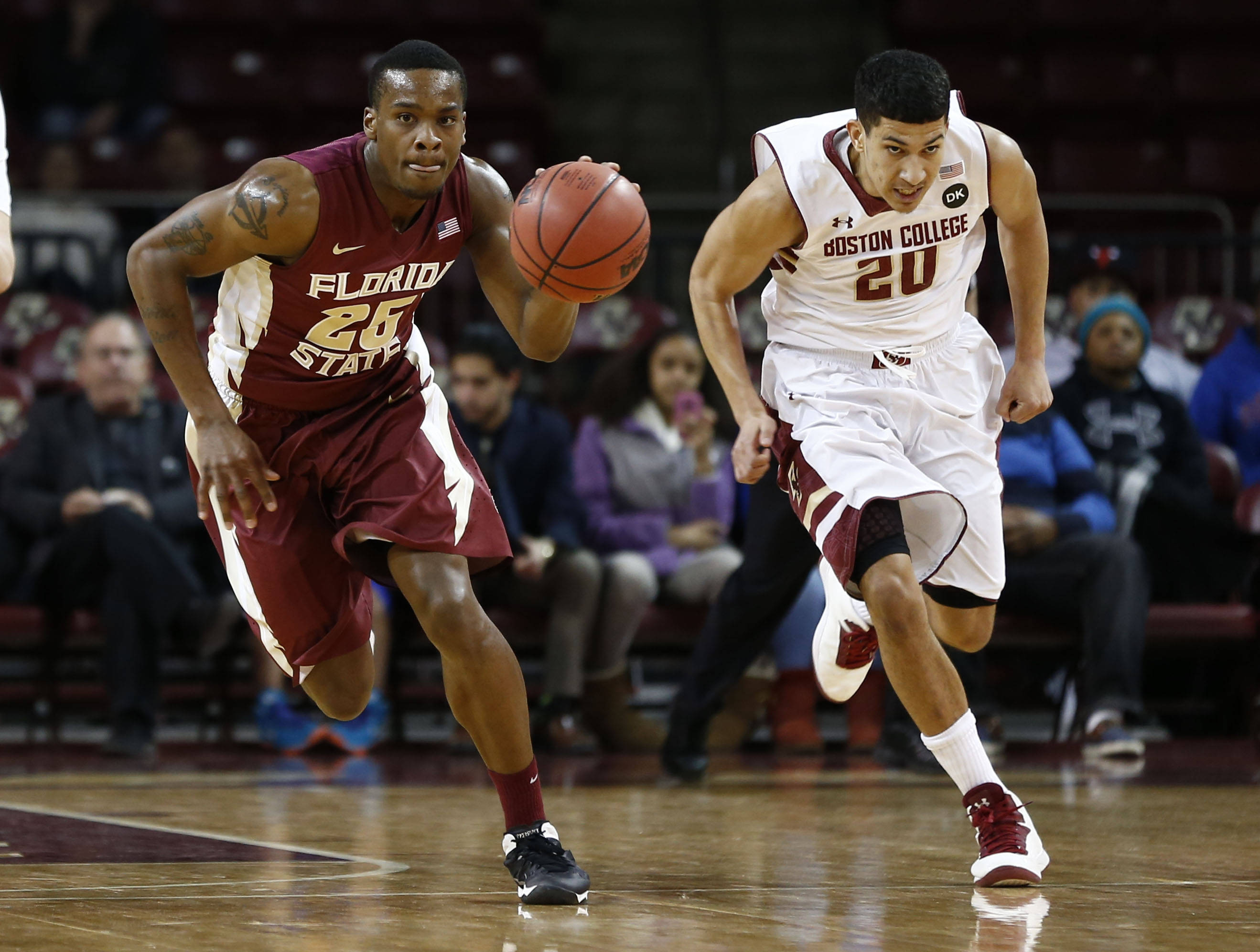Mar 4, 2014; Chestnut Hill, MA, USA; Seminoles guard Aaron Thomas (25) dribbles the ball against Boston College Eagles guard Lonnie Jackson (20) during the first half. Mark L. Baer-USA TODAY Sports