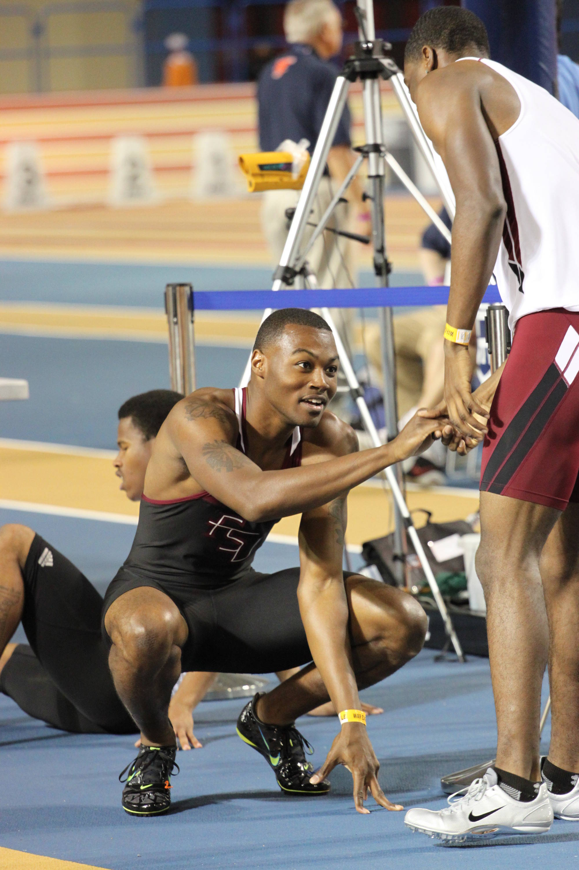 Williams get a congratulatory handshake from a South Carolina runner at the conclusion of his 400 leg.
