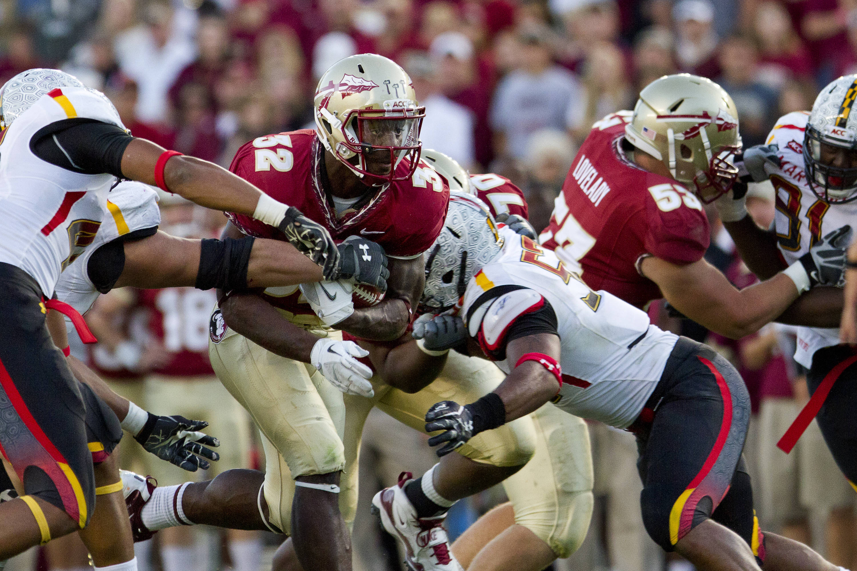 Jr. Wilder James (32) runs the ball through Maryland defenders during the football game against Maryland in Tallahassee, Florida on October 22, 2011.