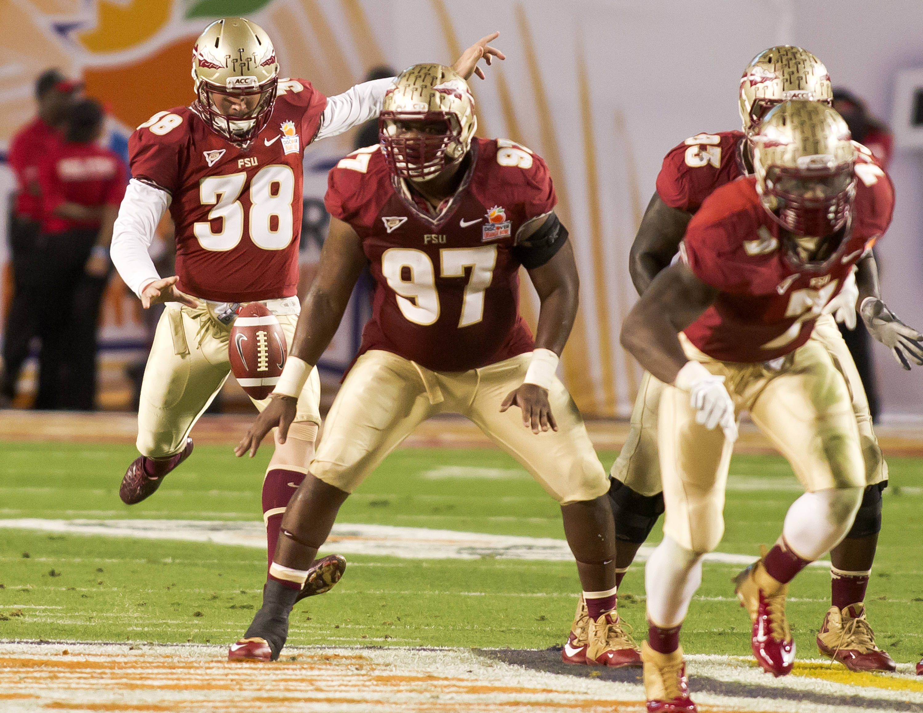 Cason Beatty (38), Demonte McAllister (97), FSU vs No. Illinois, 01/01/13. (Photo by Steve Musco)