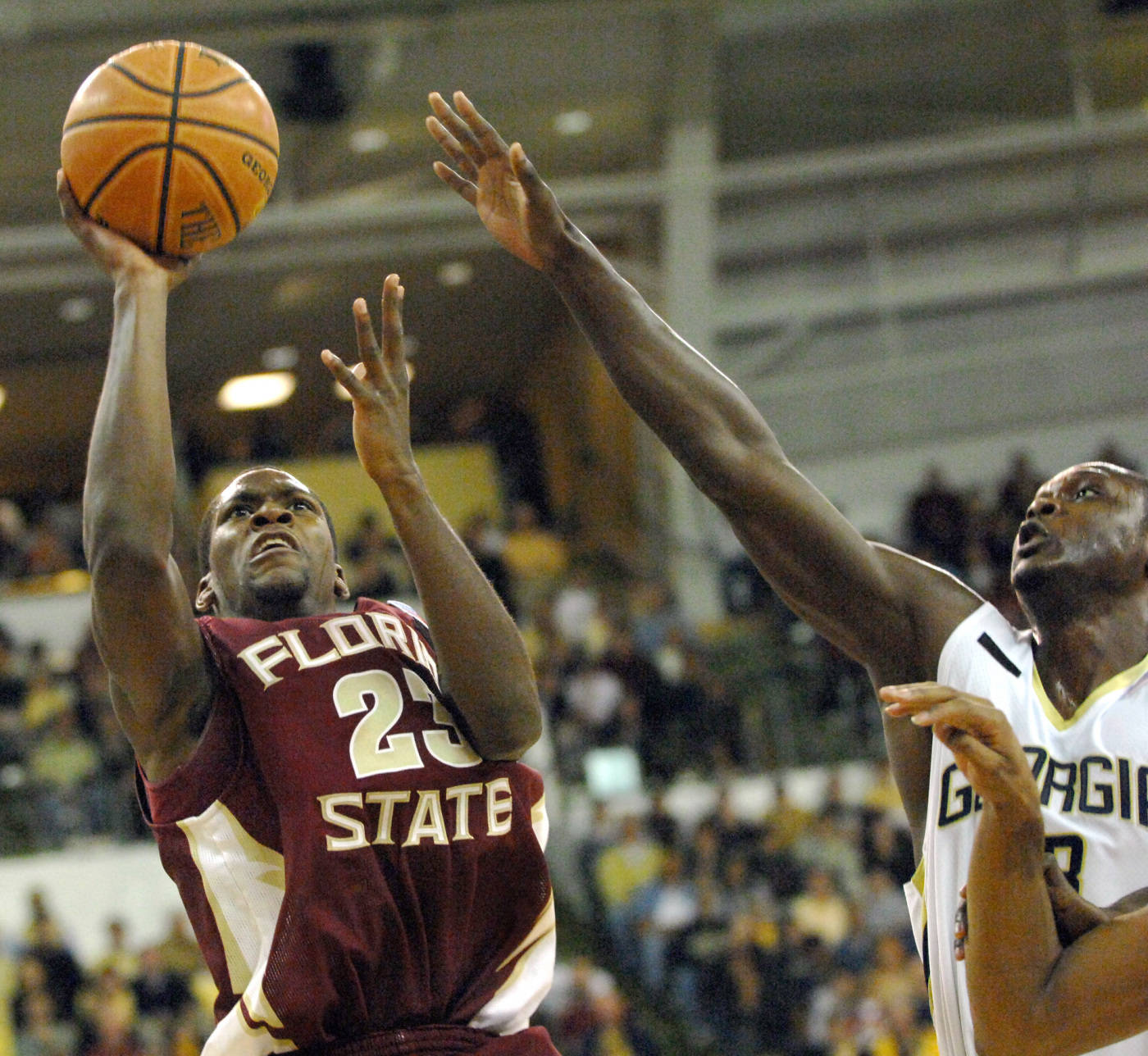 Florida State guard Toney Douglas takes a shot as he is fouled by Georgia Tech forward D'Andre Bell during the first half.