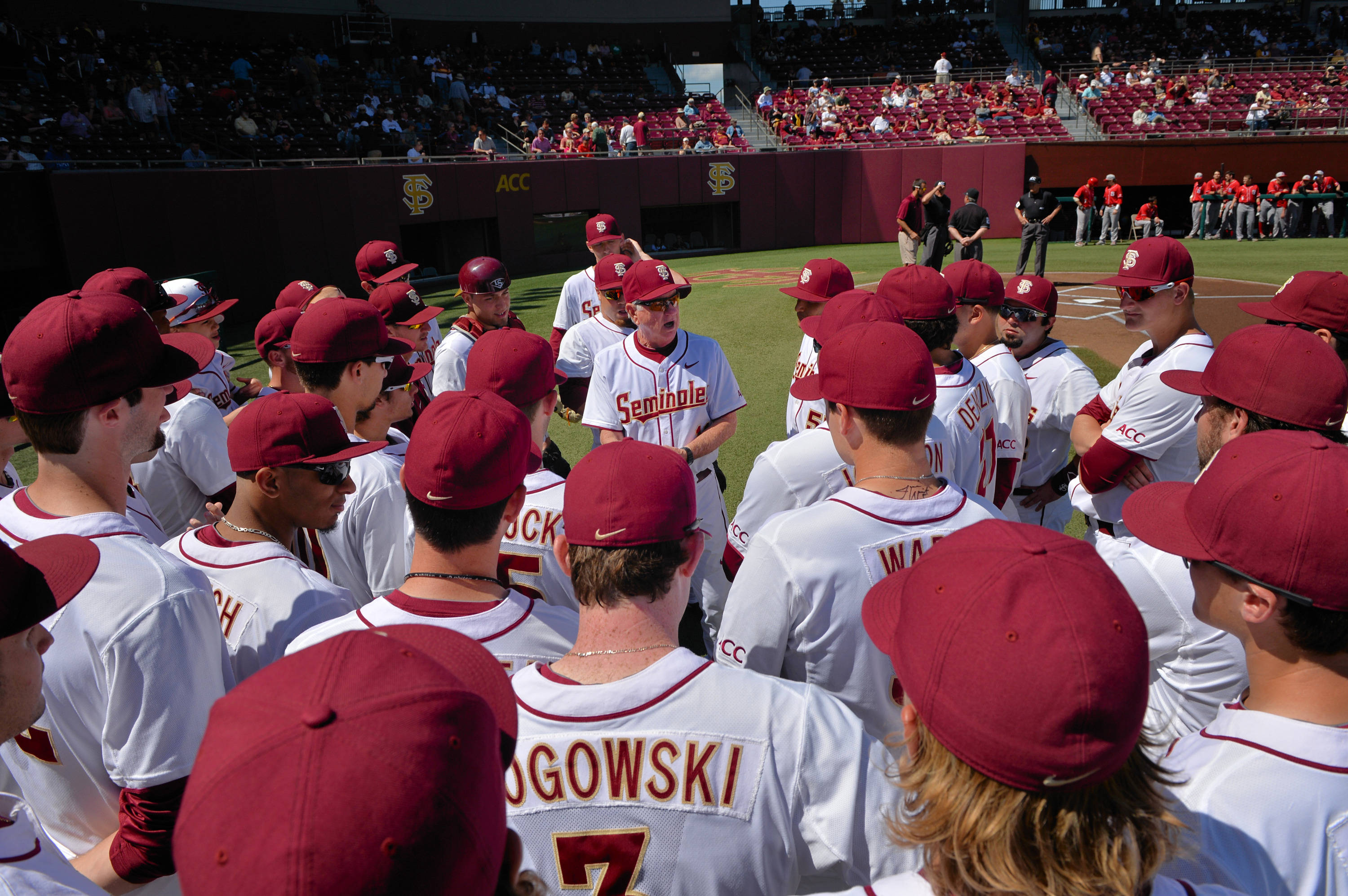 Head coach Mike Martin address the Seminoles before the start of game one against NC State on Saturday.