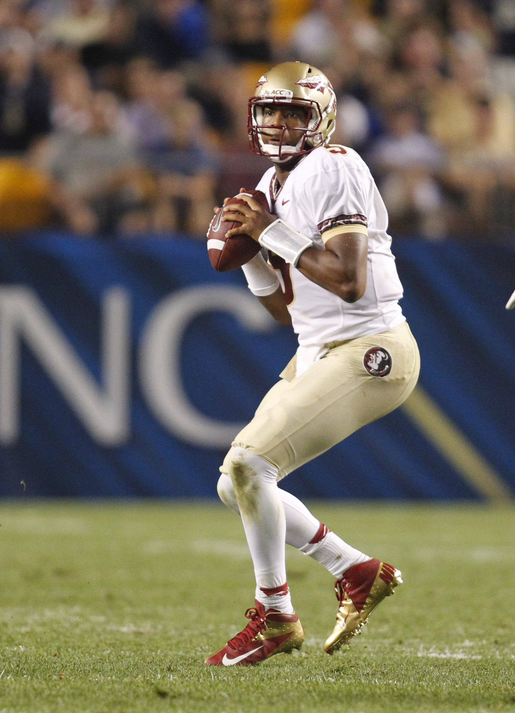 Florida State Seminoles quarterback Jameis Winston (5) looks to pass the ball against the Pittsburgh Panthers during the second quarter at Heinz Field. Mandatory Credit: Charles LeClaire-USA TODAY Sports