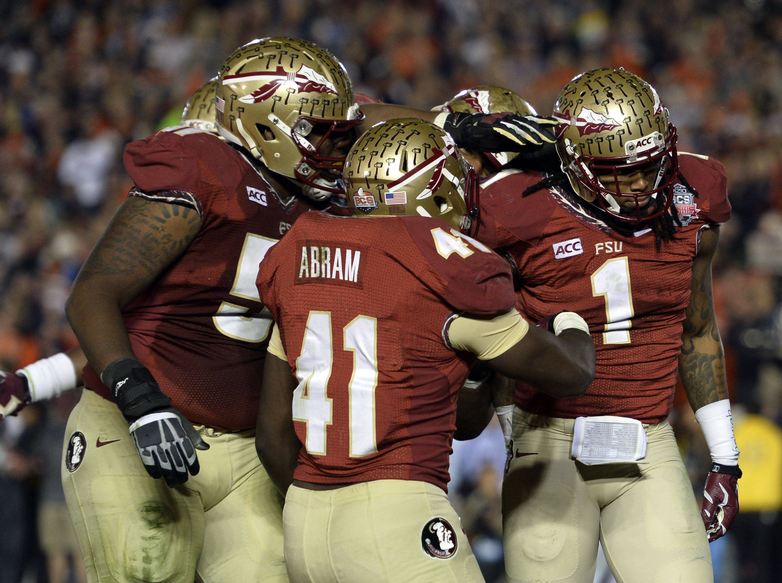 Jan 6, 2014; Pasadena, CA, USA; Florida State Seminoles wide receiver Kelvin Benjamin (1) celebrates with teammates after scoring a touchdown against the Auburn Tigers during the second half of the 2014 BCS National Championship game at the Rose Bowl.  Mandatory Credit: Robert Hanashiro-USA TODAY Sports