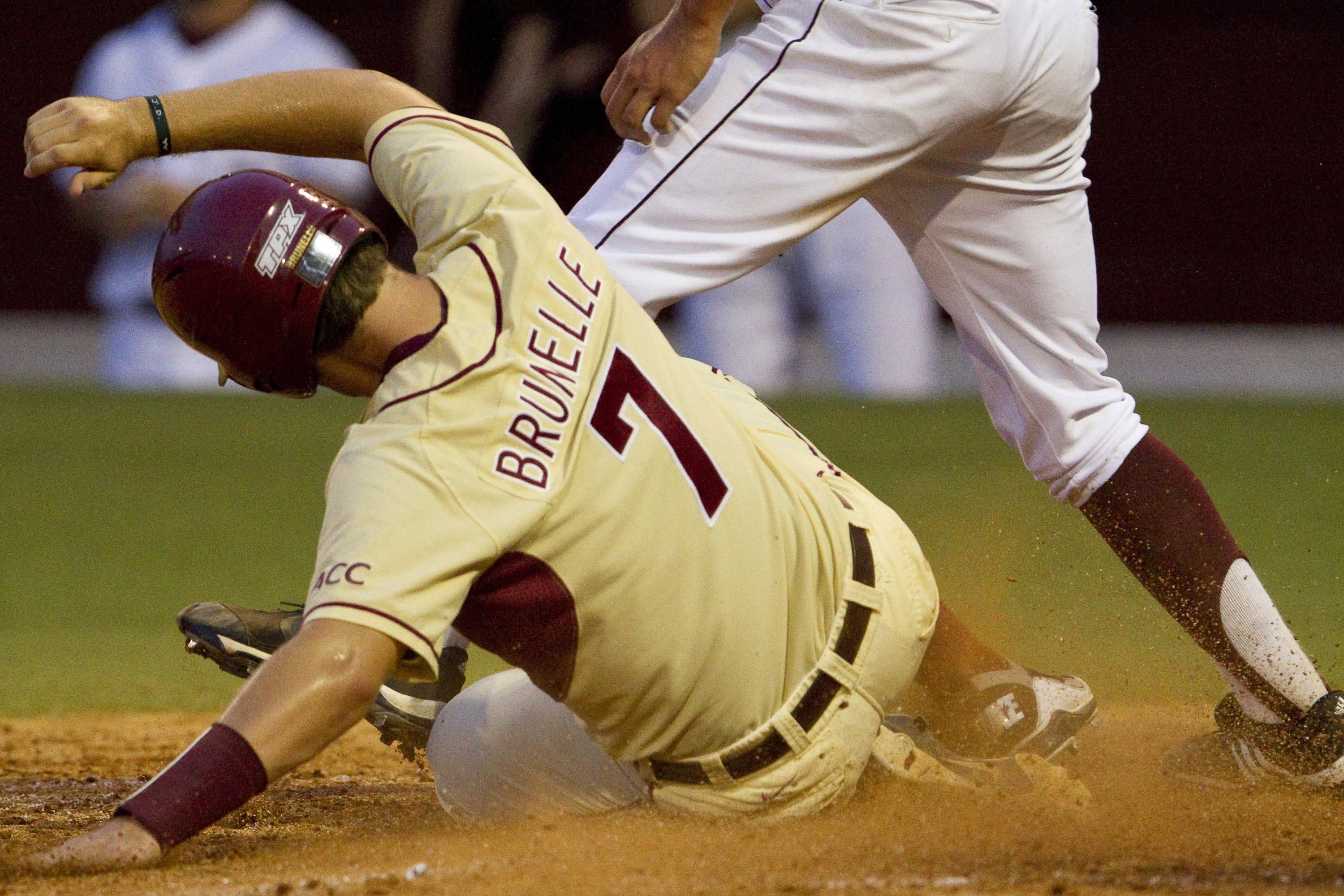 Parker Brunelle (7) slides into home plate.