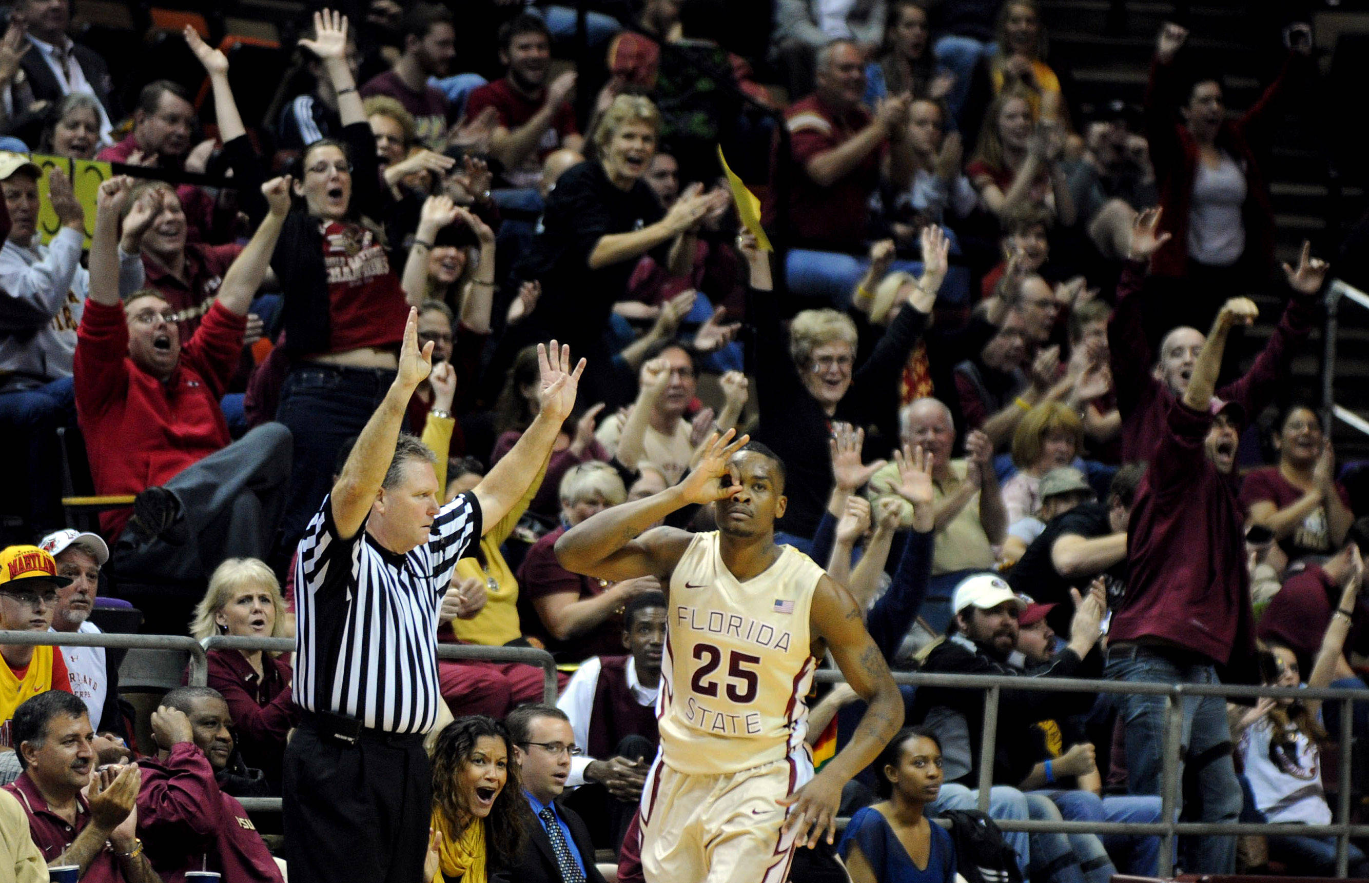 Jan 12, 2014; Tallahassee, FL, USA; Florida State Seminoles guard Aaron Thomas (25) celebrates after making a three point shot during the first half of the game against the Maryland Terrapins at Donald L. Tucker Center. Mandatory Credit: Melina Vastola-USA TODAY Sports