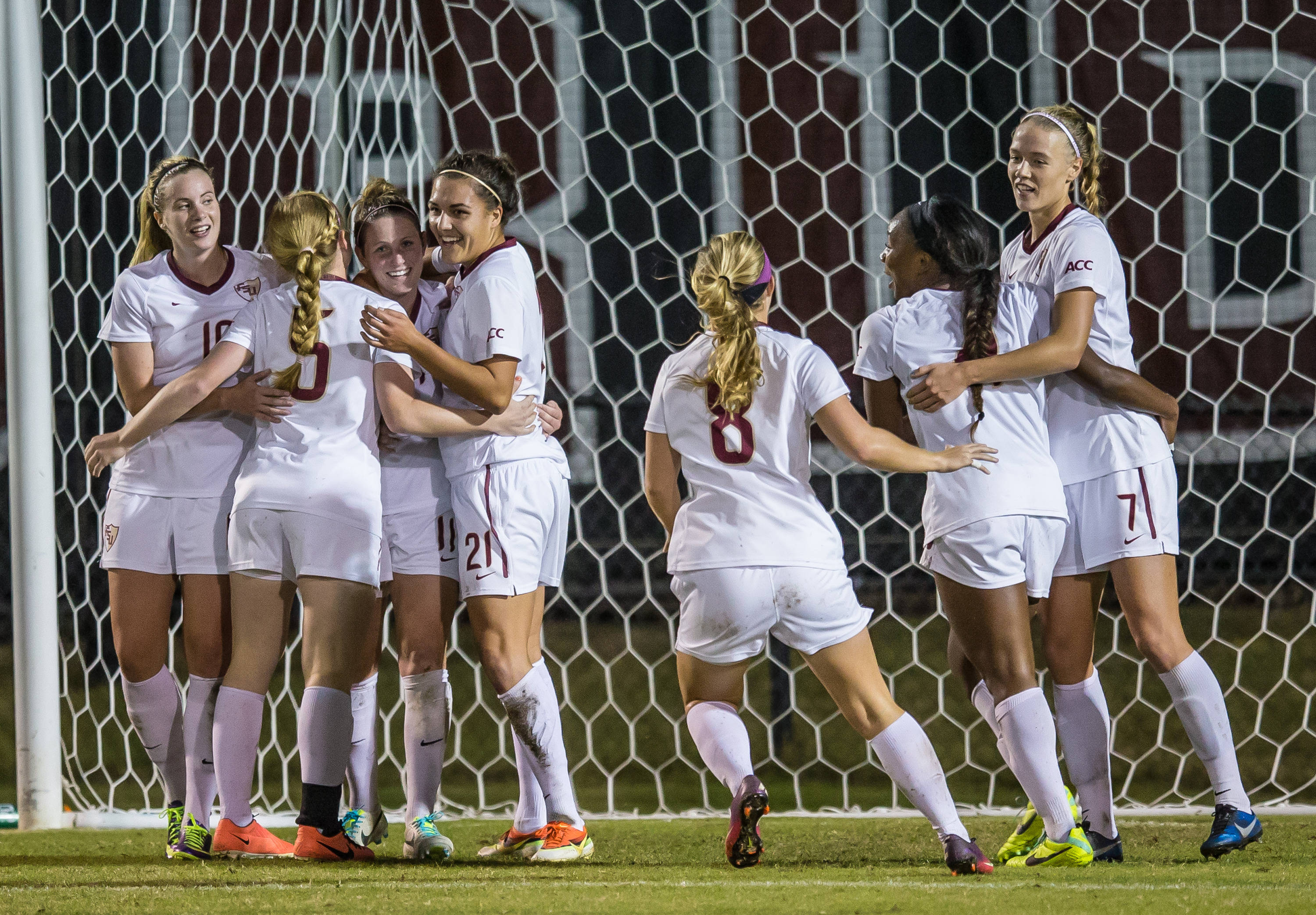 Teammates celebrate Isabella Schmid's (11) goal.  FSU went on to win the second round match 3-1.