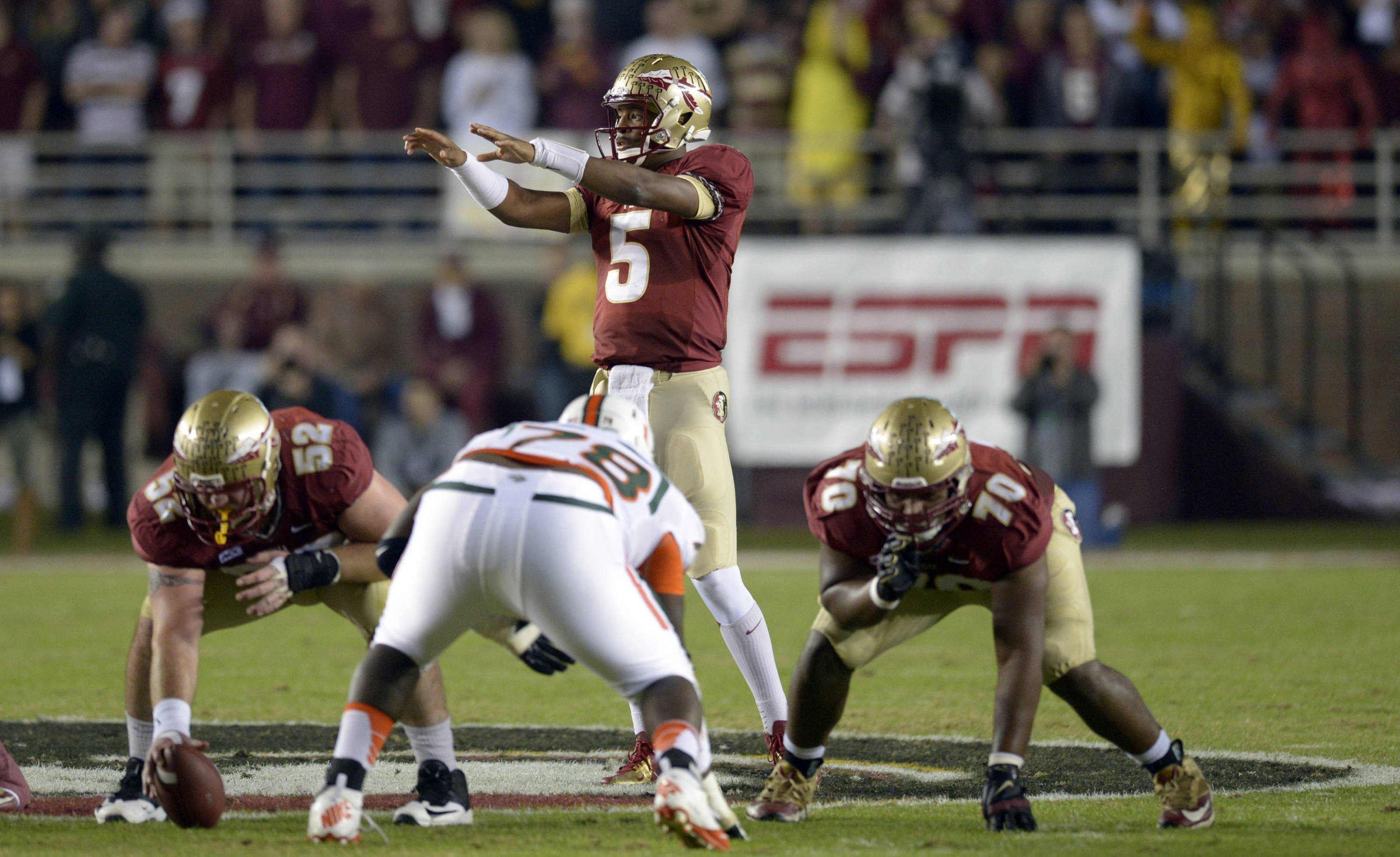 Florida State Seminoles quarterback Jameis Winston (5) signals the defense at the line against the Miami Hurricanes during the first quarter at Doak Campbell Stadium. Mandatory Credit: John David Mercer-USA TODAY Sports