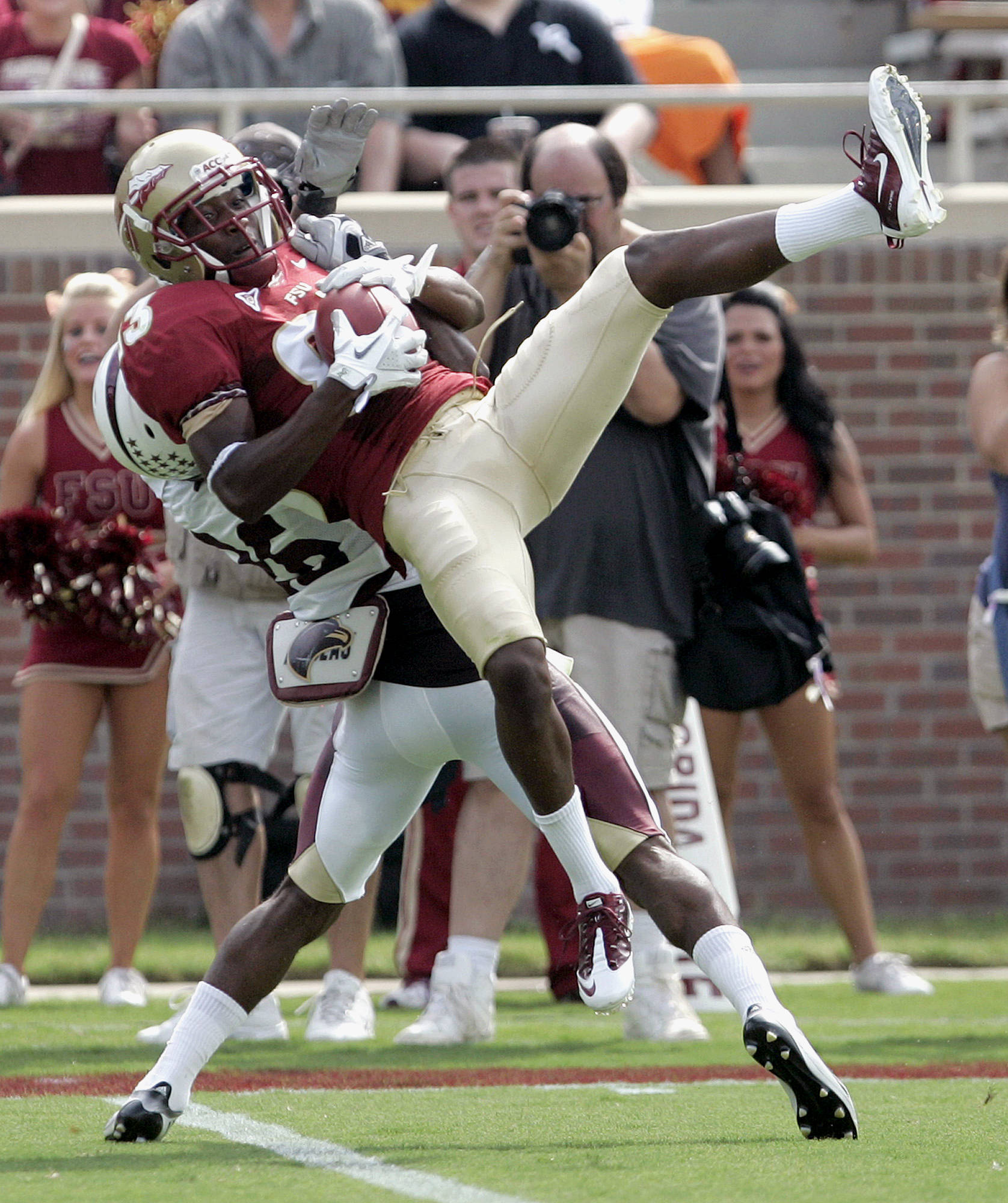 Florida State's Bert Reed makes a catch over the defense of Louisiana-Monroe's Cordero Smith in the second quarter of a NCAA college football game, Saturday, Sept. 3, 2011, in Tallahassee, Fla. (AP Photo/Steve Cannon)