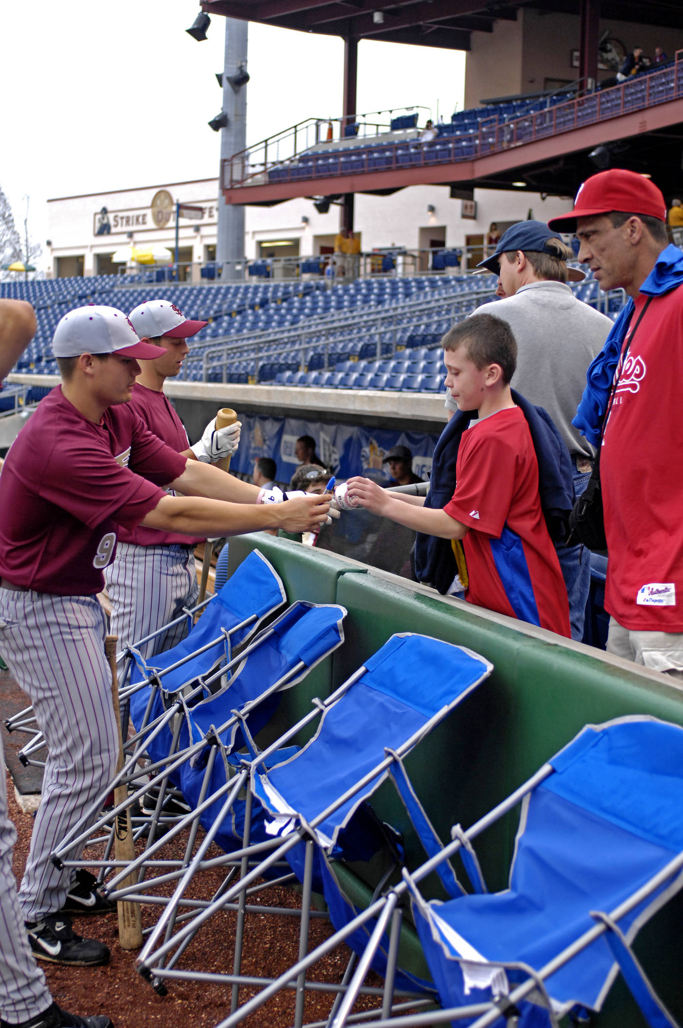 Ruairi O'Connor and Mike McGee take time for autographs before Tuesday's exhibition