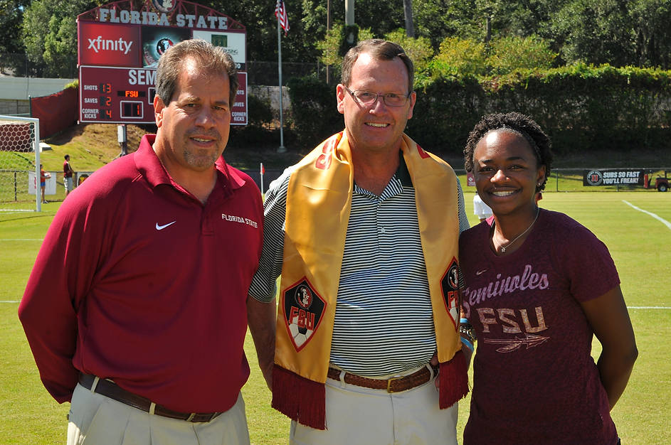 Head coach Mark Krikorian, Bob Smith and Brandi Stuart