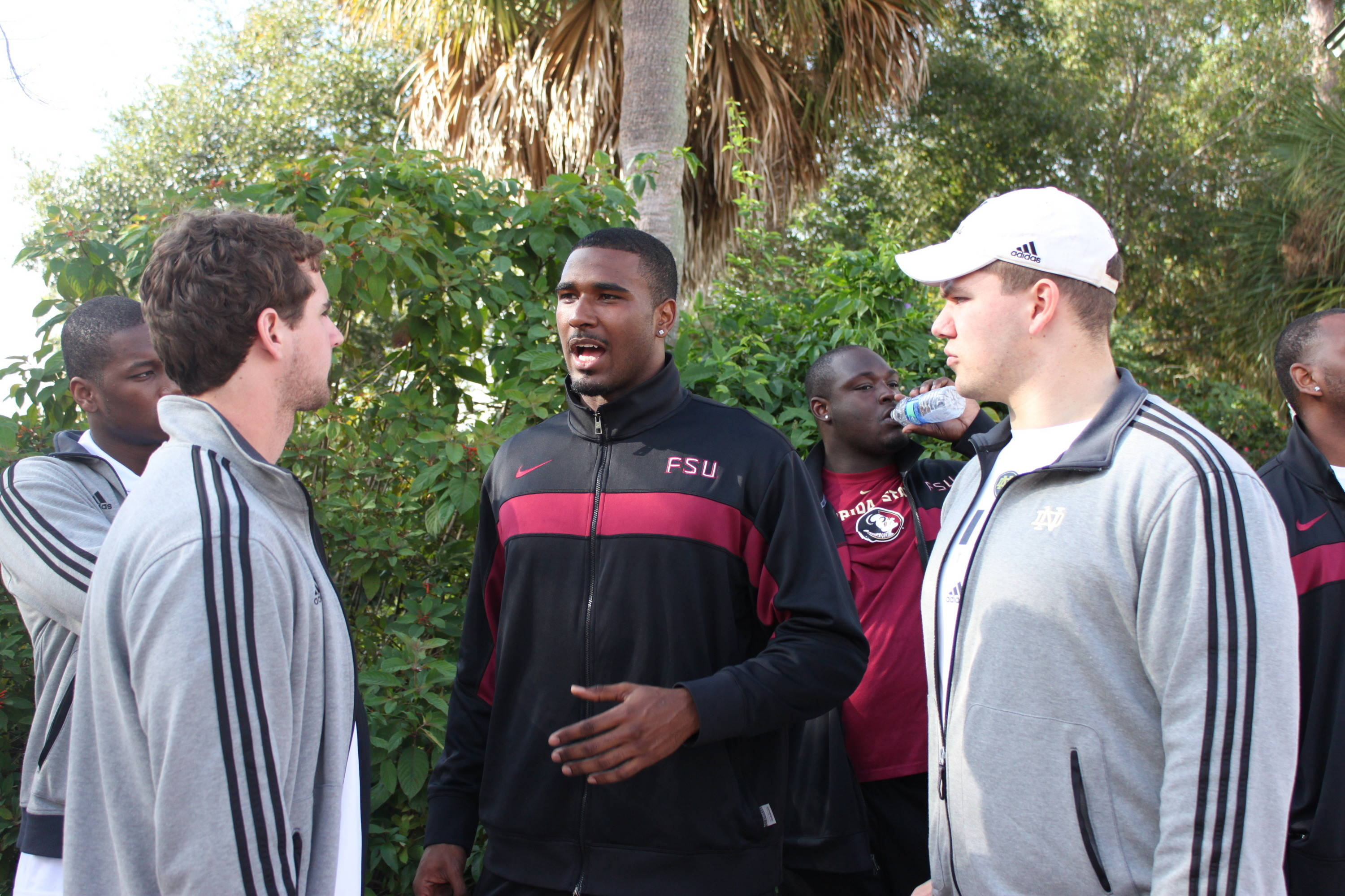 Quarterback EJ Manuel chats with a pair of Fighting Irish players during the two-hour gathering.