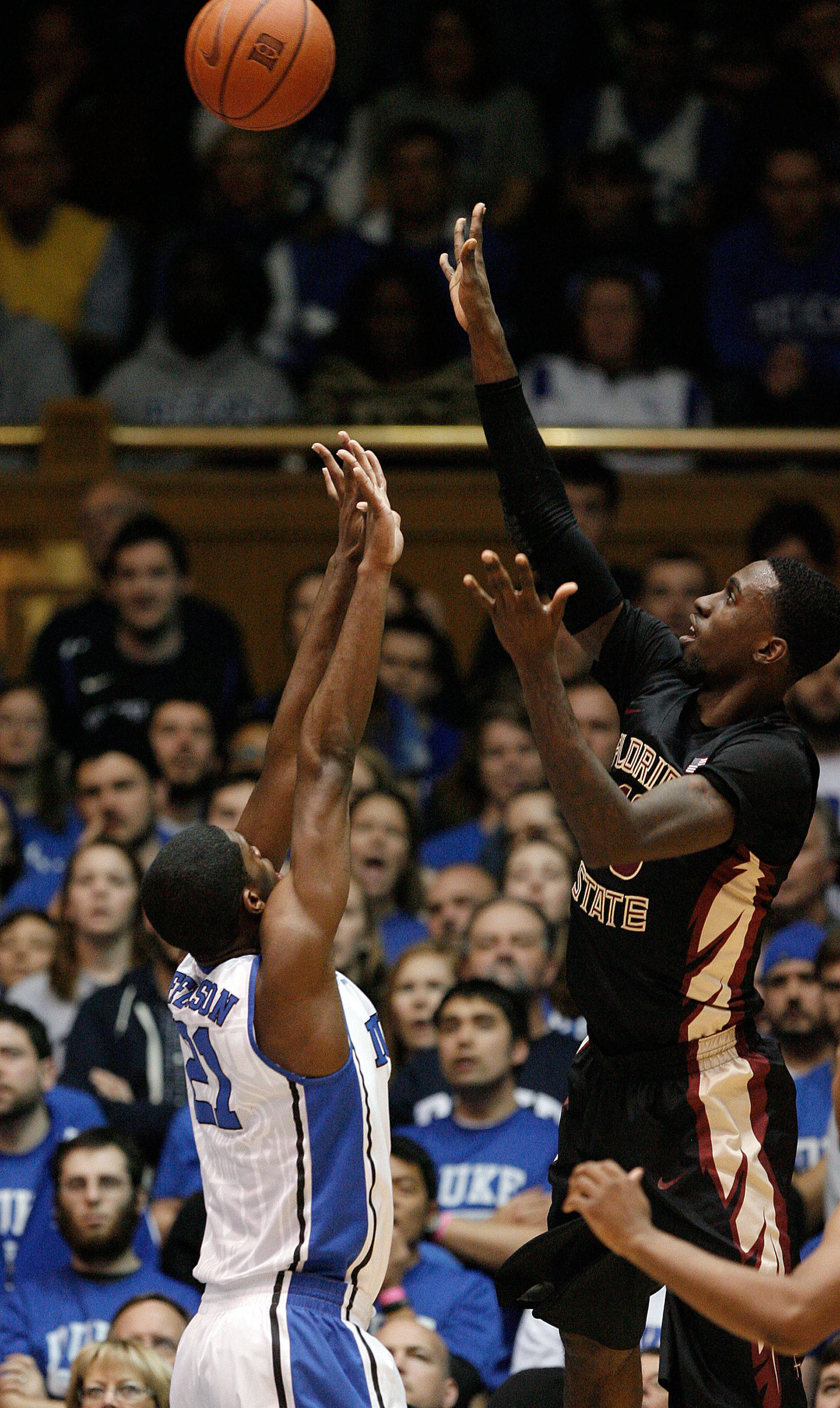Jan 25, 2014; Durham, NC, USA; Seminoles forward Okaro White (10) shoots over Duke Blue Devils forward Amile Jefferson (21). Mark Dolejs-USA TODAY Sports