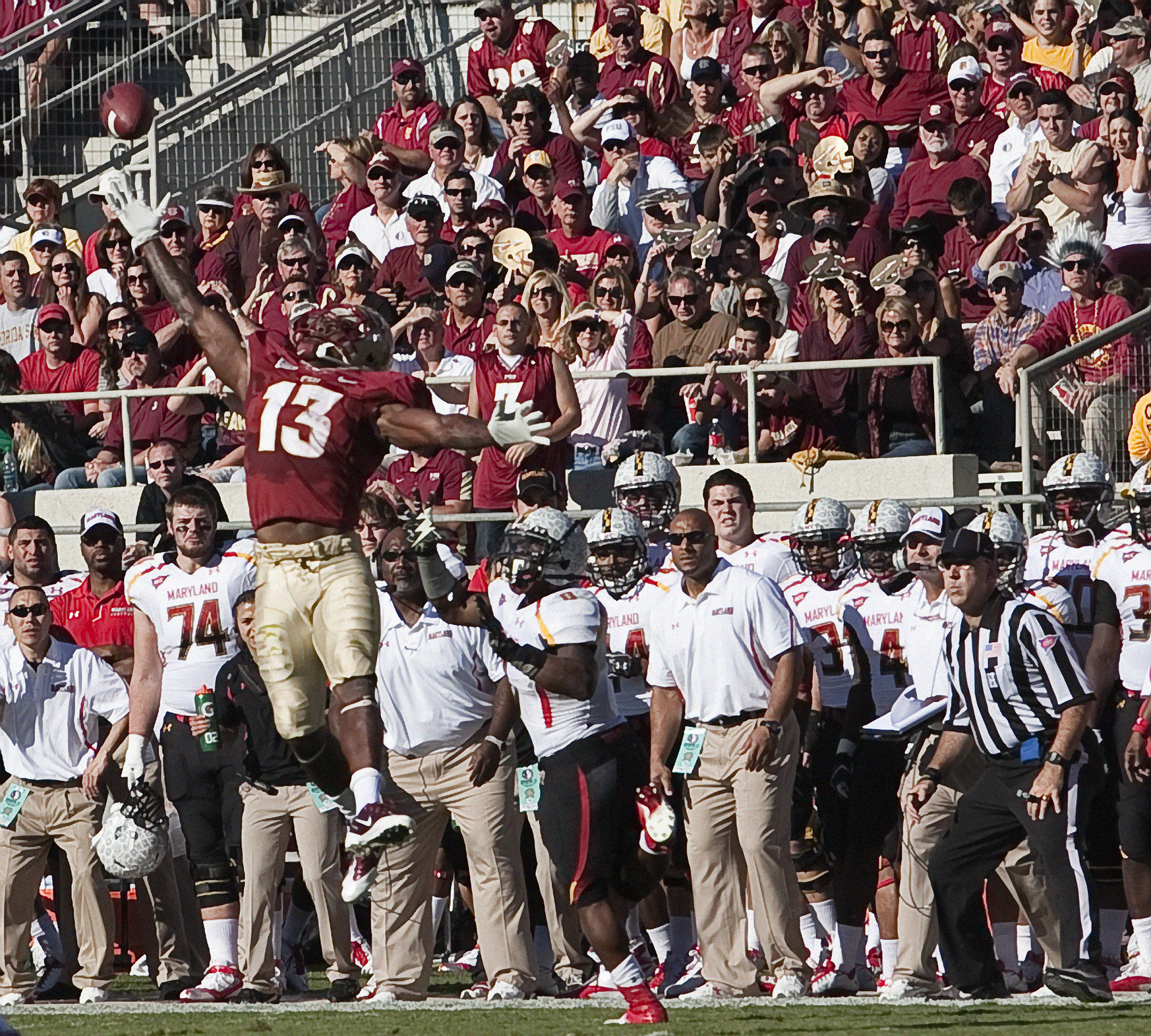 Nigel Bradham (13) goes high to disrupt a pass play. FSU vs Maryland 10/22/1111