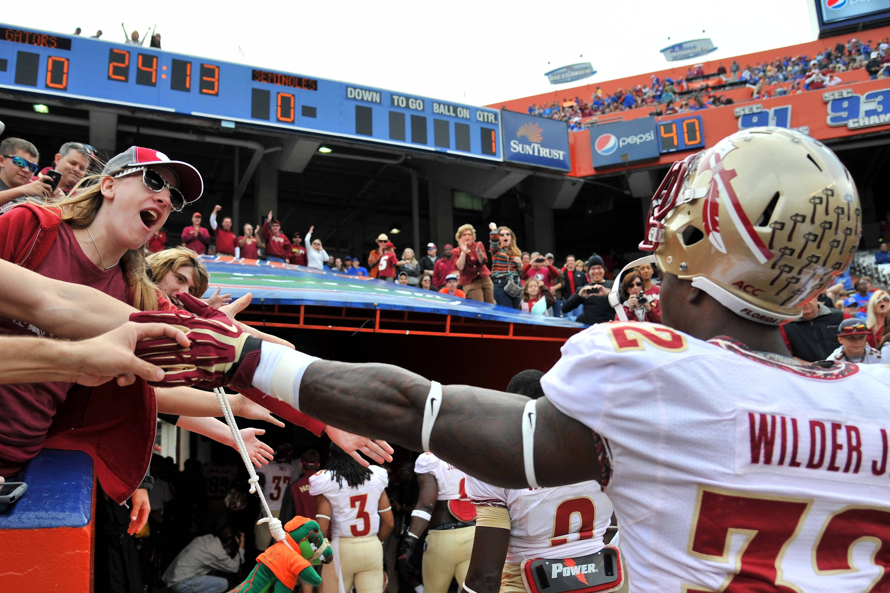 James Wilder Jr. (32) greets fans prior to a game. Mandatory Credit: Steve Mitchell-USA TODAY Sports