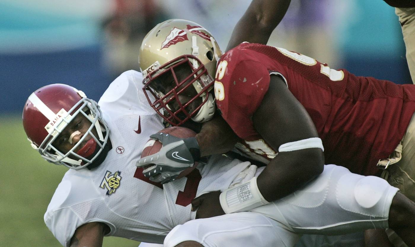 Alabama running back Roy Upchurch, bottom, is tackled by Florida State's Letroy Guion during the second quarter. (AP Photo/Phil Coale)