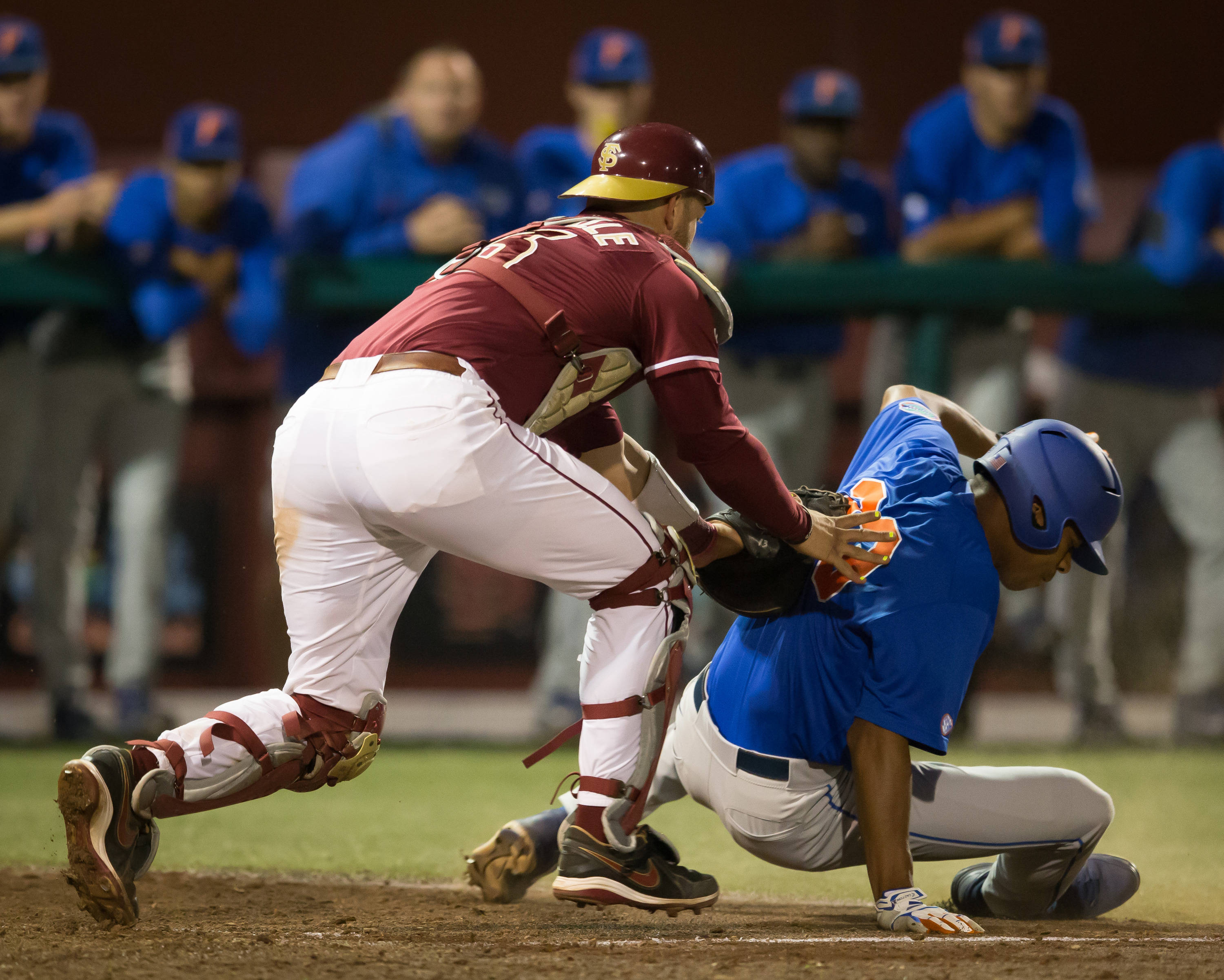 La De Calle Danny (13) tags out a Gator runner at home.