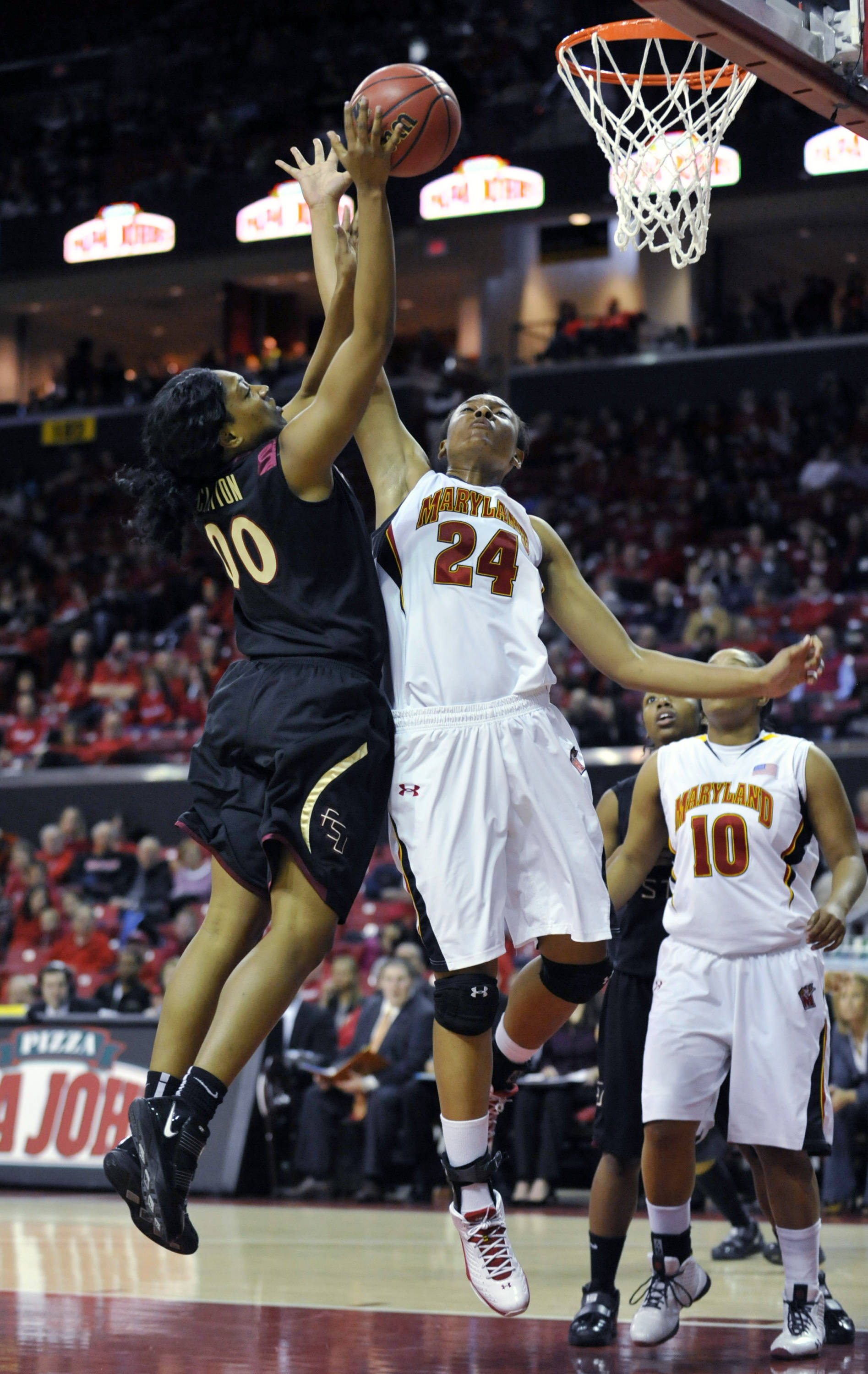 Florida State's Chasity Clayton shoots as Maryland's Diandra Tchatchouang blocks.