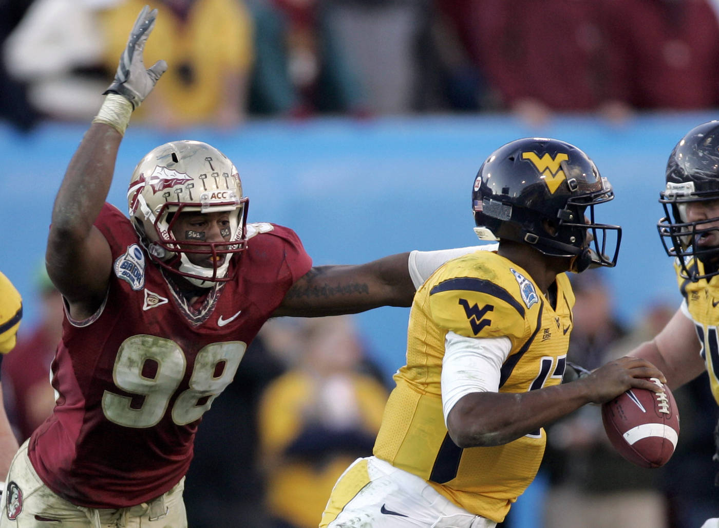 Florida State defensive tackle Jacobbi McDaniel, left, moves in for the sack on West Virginia quarterback Geno Smith during the fourth quarter of the Gator Bowl college football game on Friday, Jan. 1, 2010, in Jacksonville, Fla.  Florida State won 33-21.(AP Photo/Steve Cannon)
