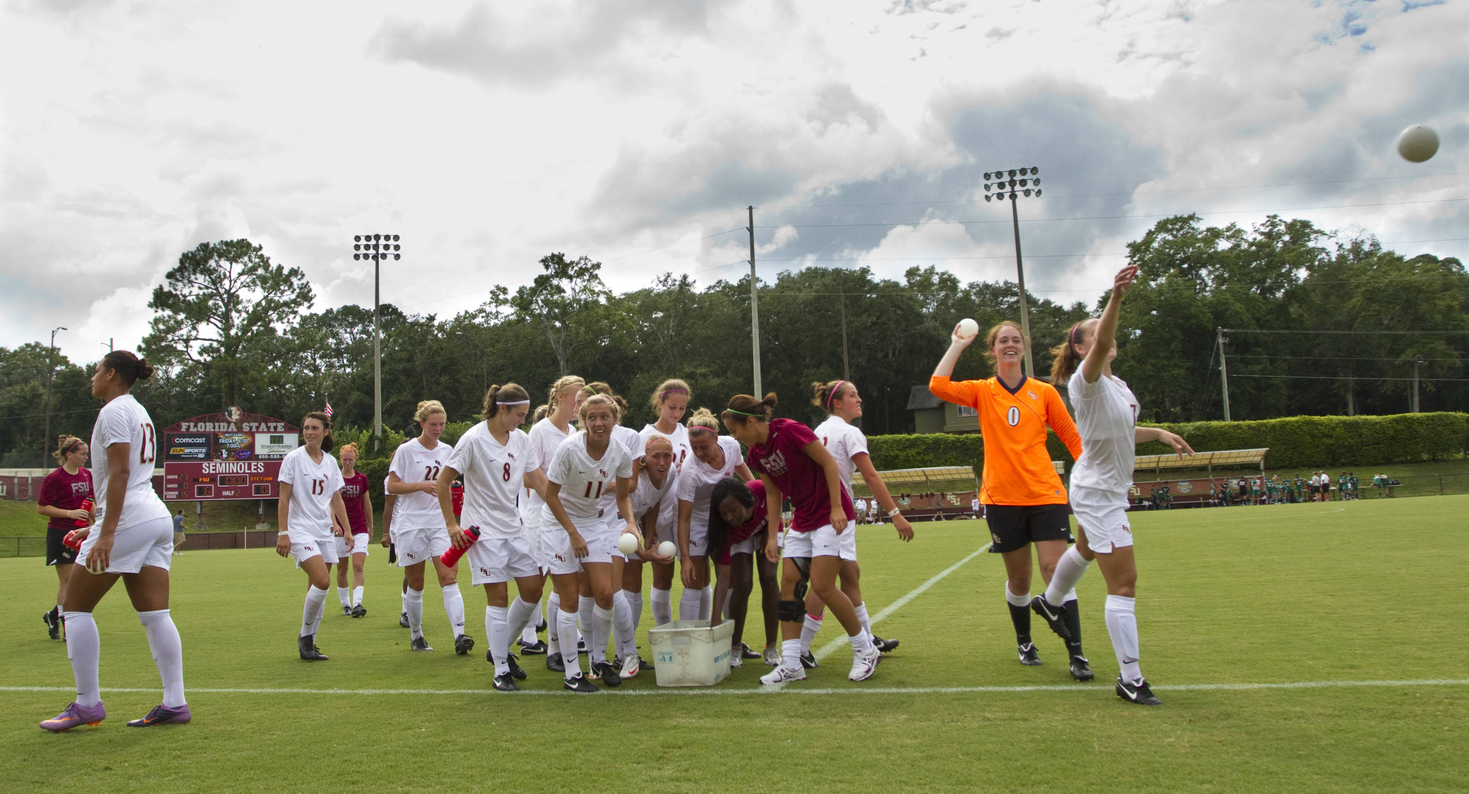 The team tosses mini-soccer balls at fans after the win against Stetson.